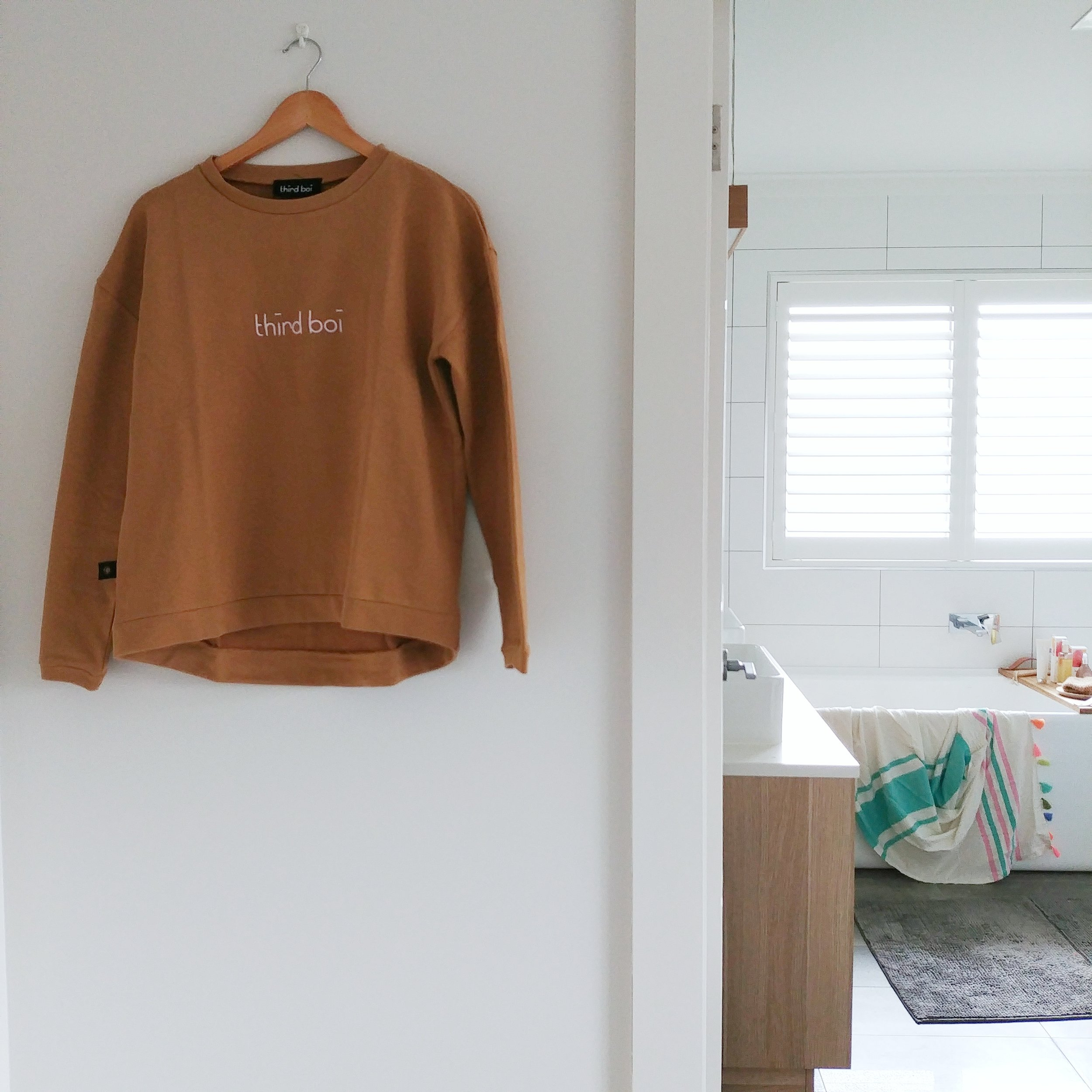 Keeping it simple at home. Photo by Lisa Lee featuring logo sweat from Third Boi.