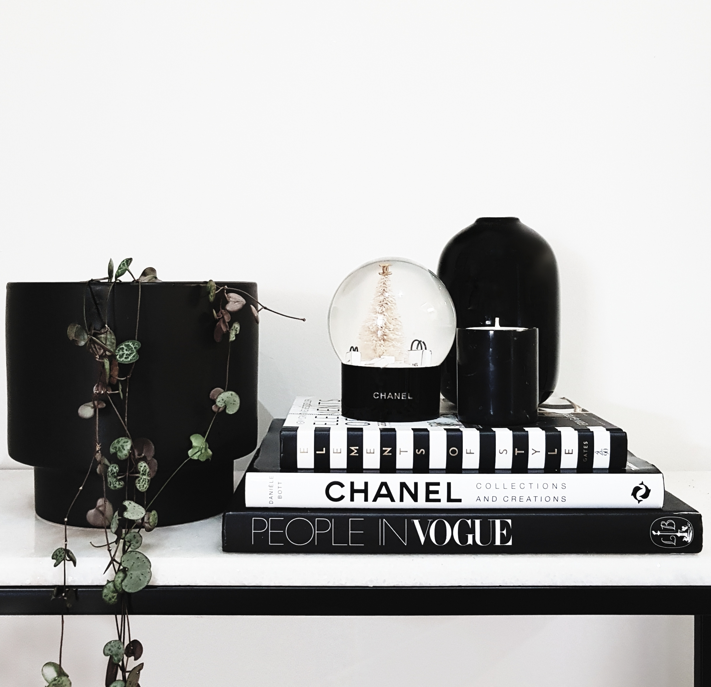 Use pieces that reflect your personality & style. I absolutely love this Chanel snowglobe & gorgeous black marble candle from Burn Baby Burn Candle Co.