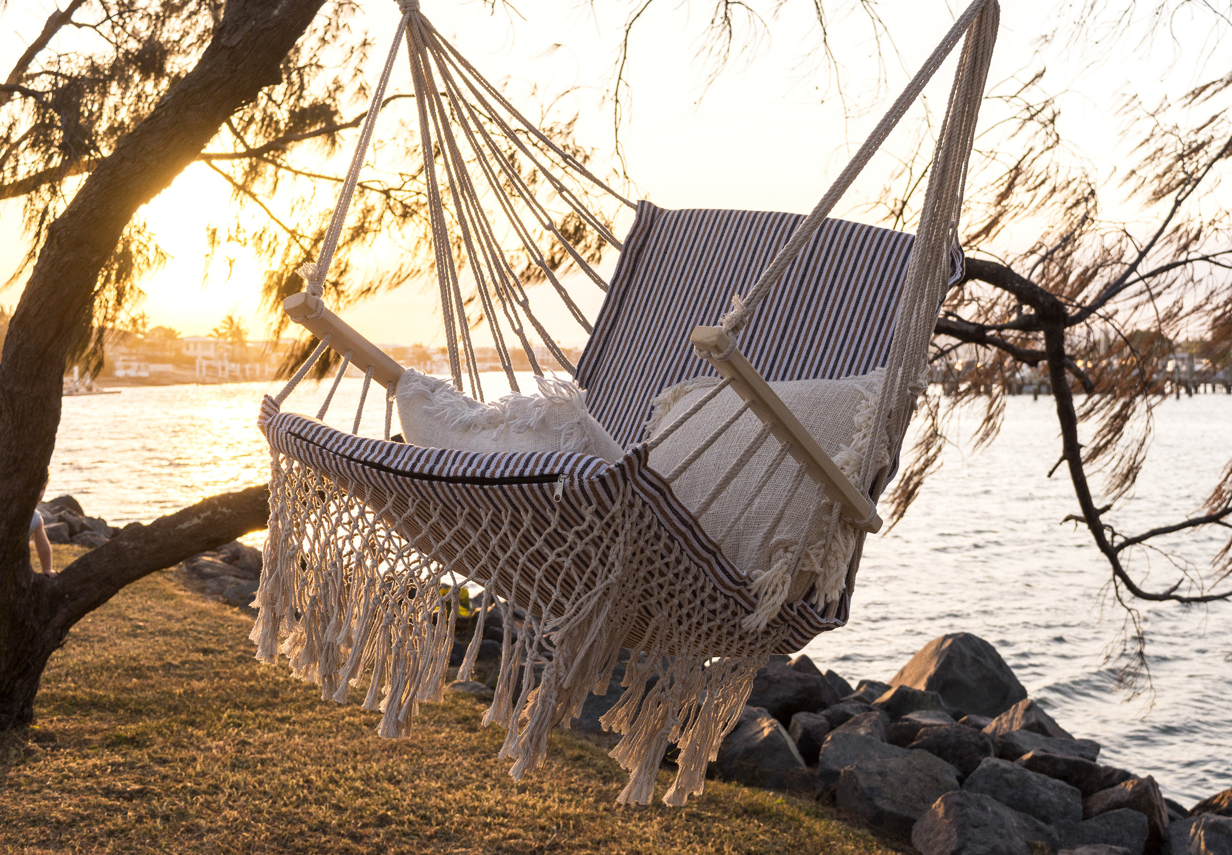Golden hour photography in warm light. Image by Creatively Squared content creator Ali for OzTrail Hammocks.