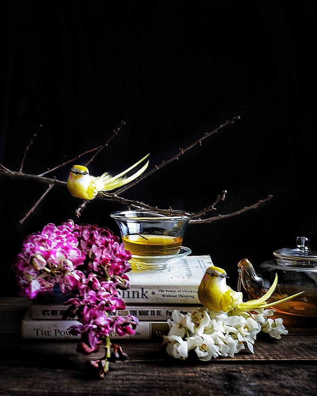 Vibrant still life with birds and flowers