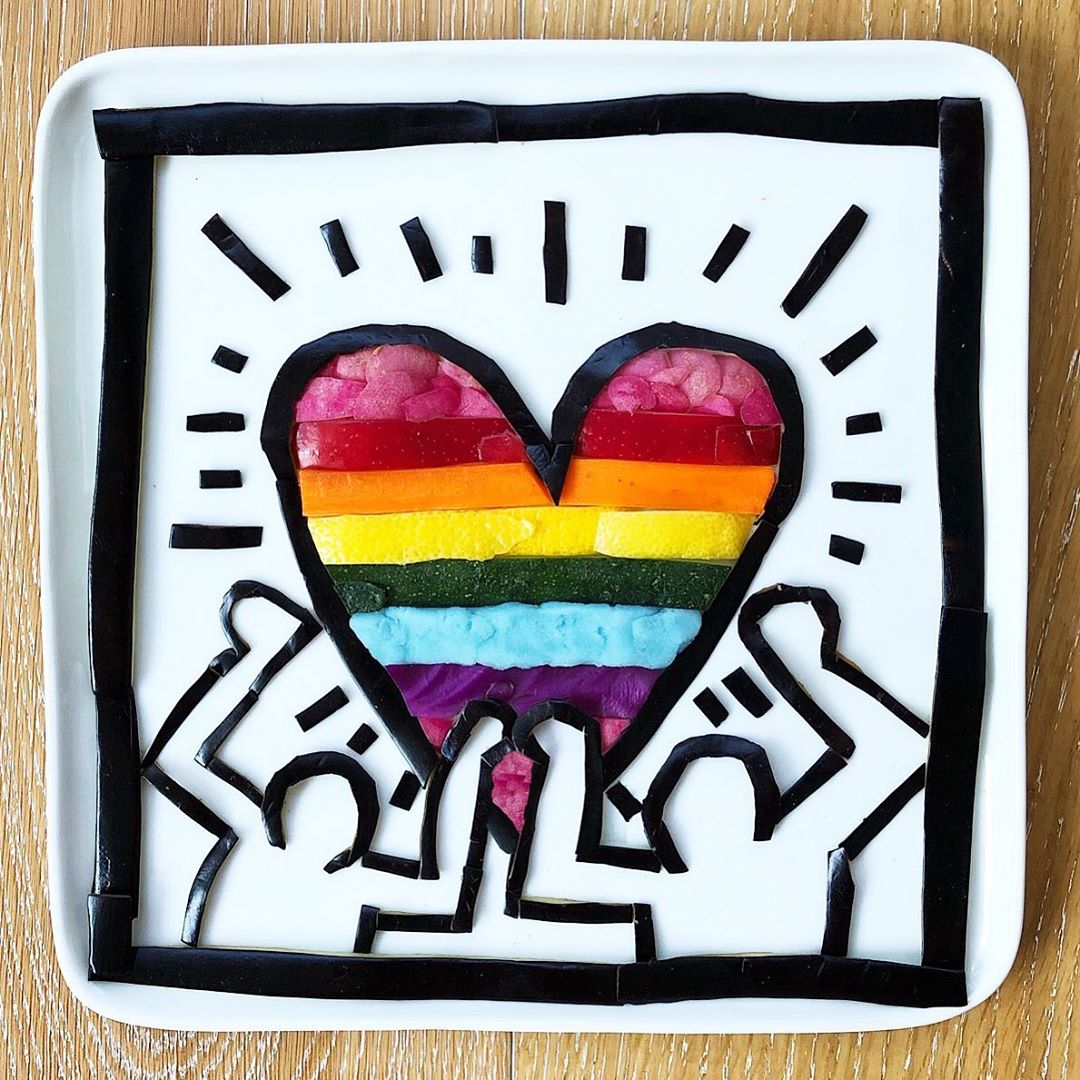 Harley's Keith Haring inspired art for Pride created with eggplant, radish, apple, lemon, carrot, zucchini, red cabbage, and mashed potatoes dyed with natural food coloring.  Image via @harleysfood_art on Instagram