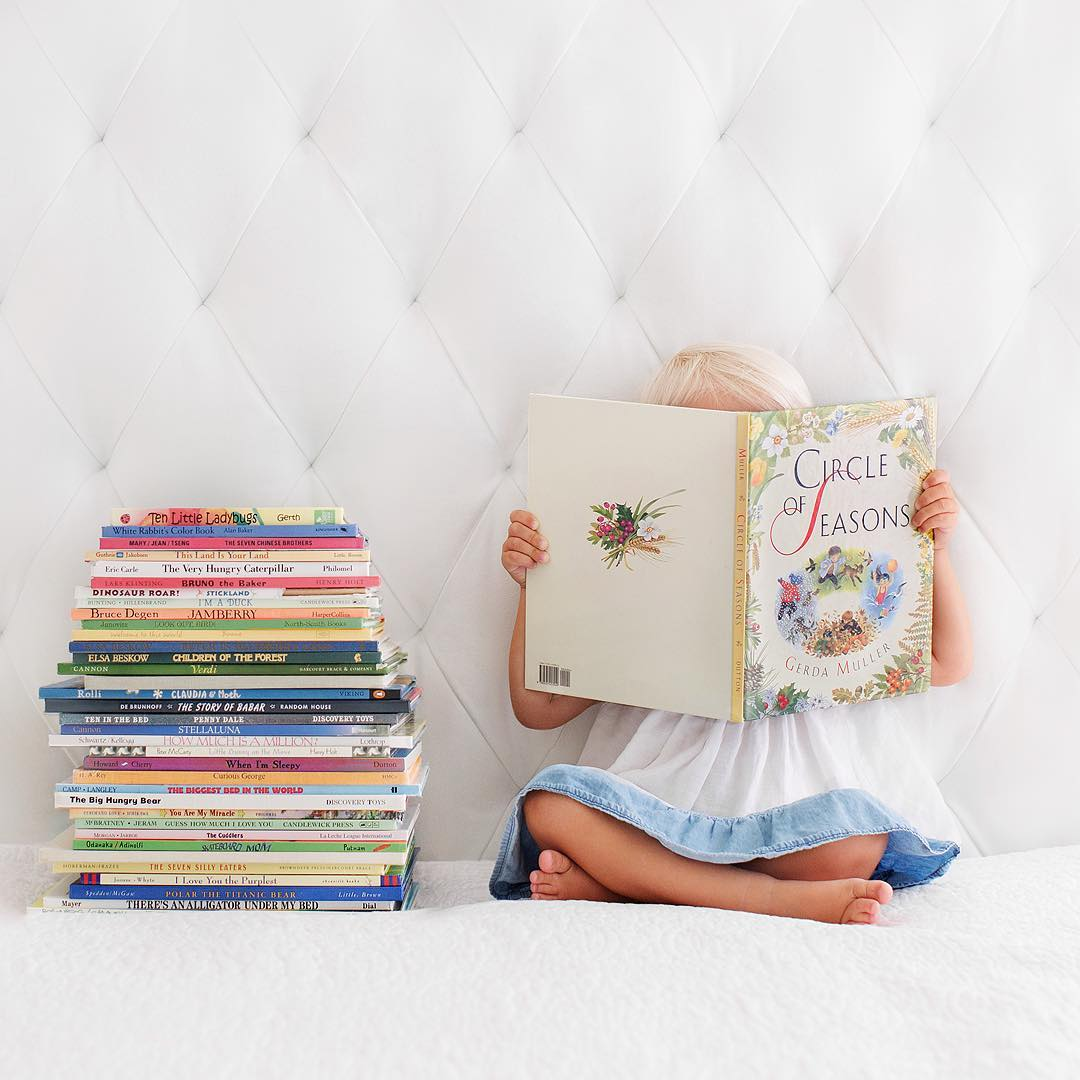 Books are always a handy prop, and very handy if you don't want to show your little one's face. Source:  @pattischmidt