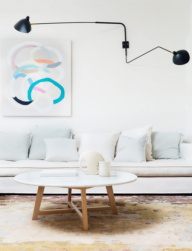 Arent&Pyke via My Domaine  The art in this living room space contrasts the otherwise very neutral palette.