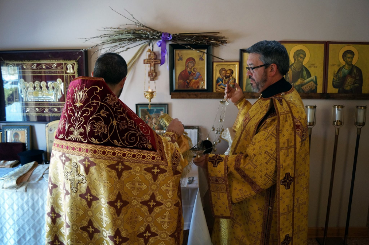 Fr. Gabriel and Dn. Mike preparing the host for Divine Liturgy
