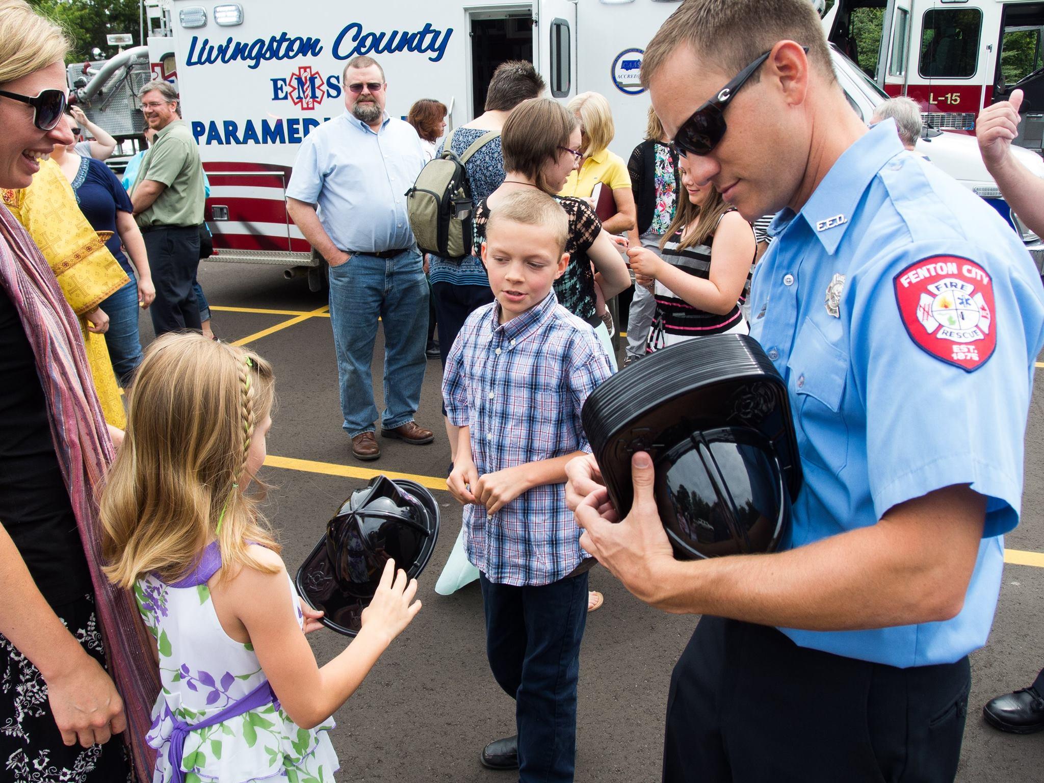 Firemen handing out Hats.jpg