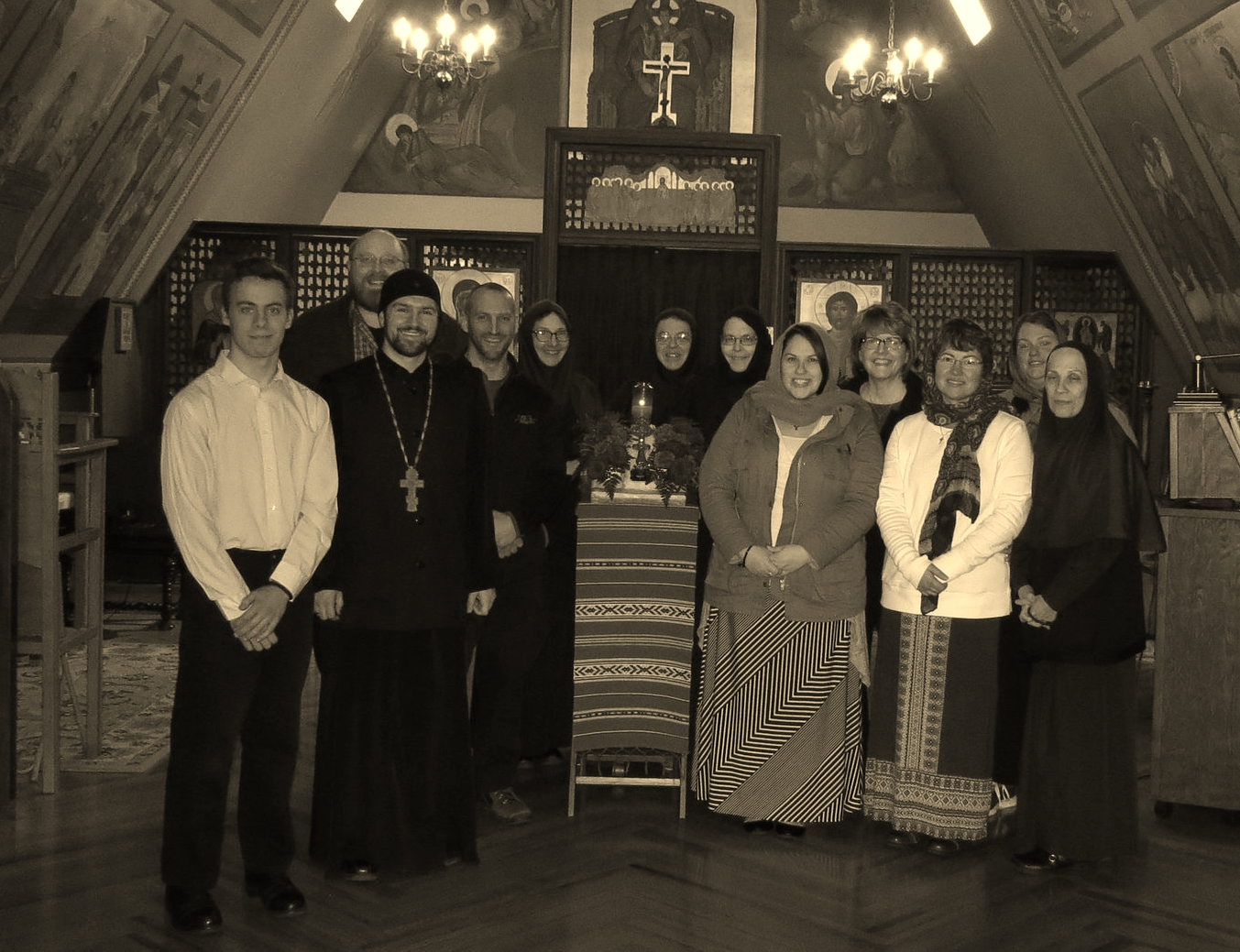 Pilgrims taking a photo with Mother Christophora and the Sisters, next to a piece of the true cross, given to the monastery by Mother Alexandra (Monastery founder).