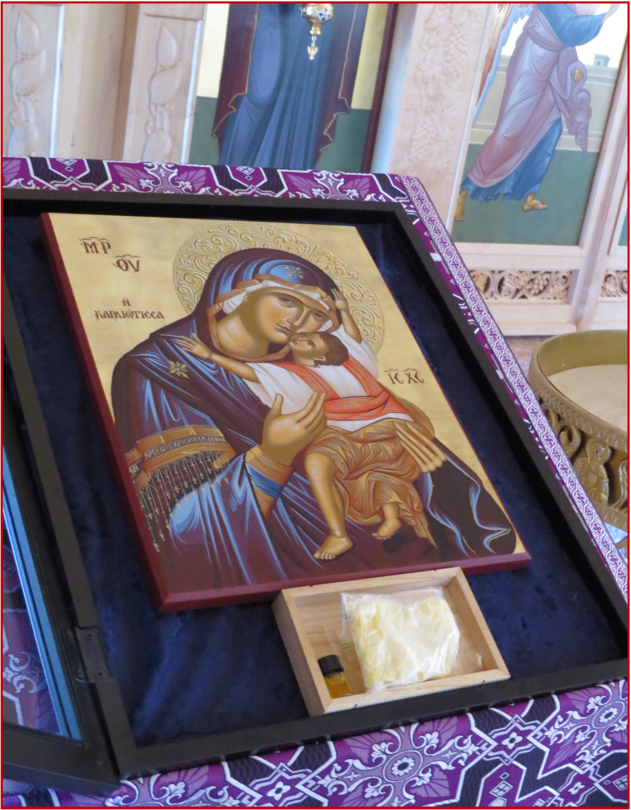 A Copy of the Myrrh Streaming Icon with some of the cotton which absorbs the tears which flow from the original icon.