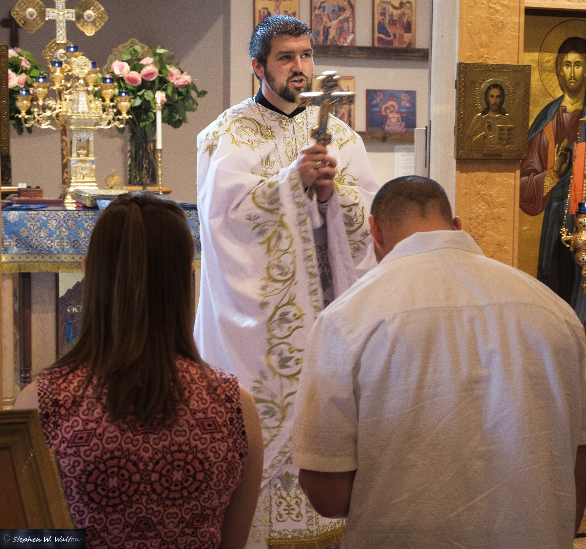 Fr. Gabriel offers the final blessing of the Divine Liturgy, with Theophan and his daughter Nyomi