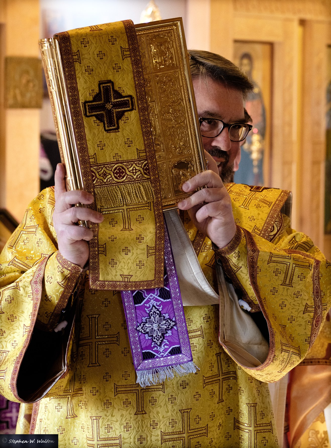 deacon carrying the gospel