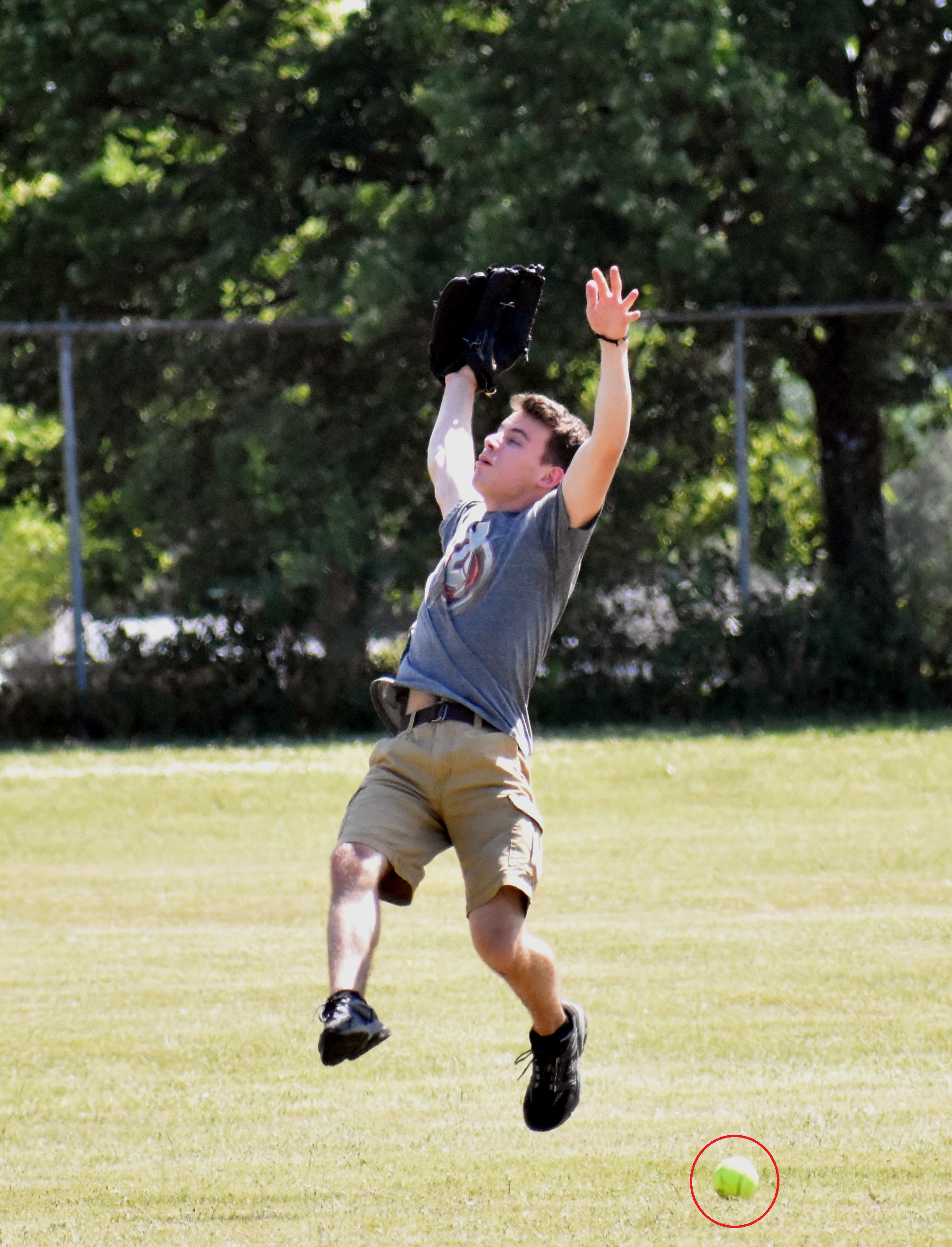 young male player jumping to catch ball