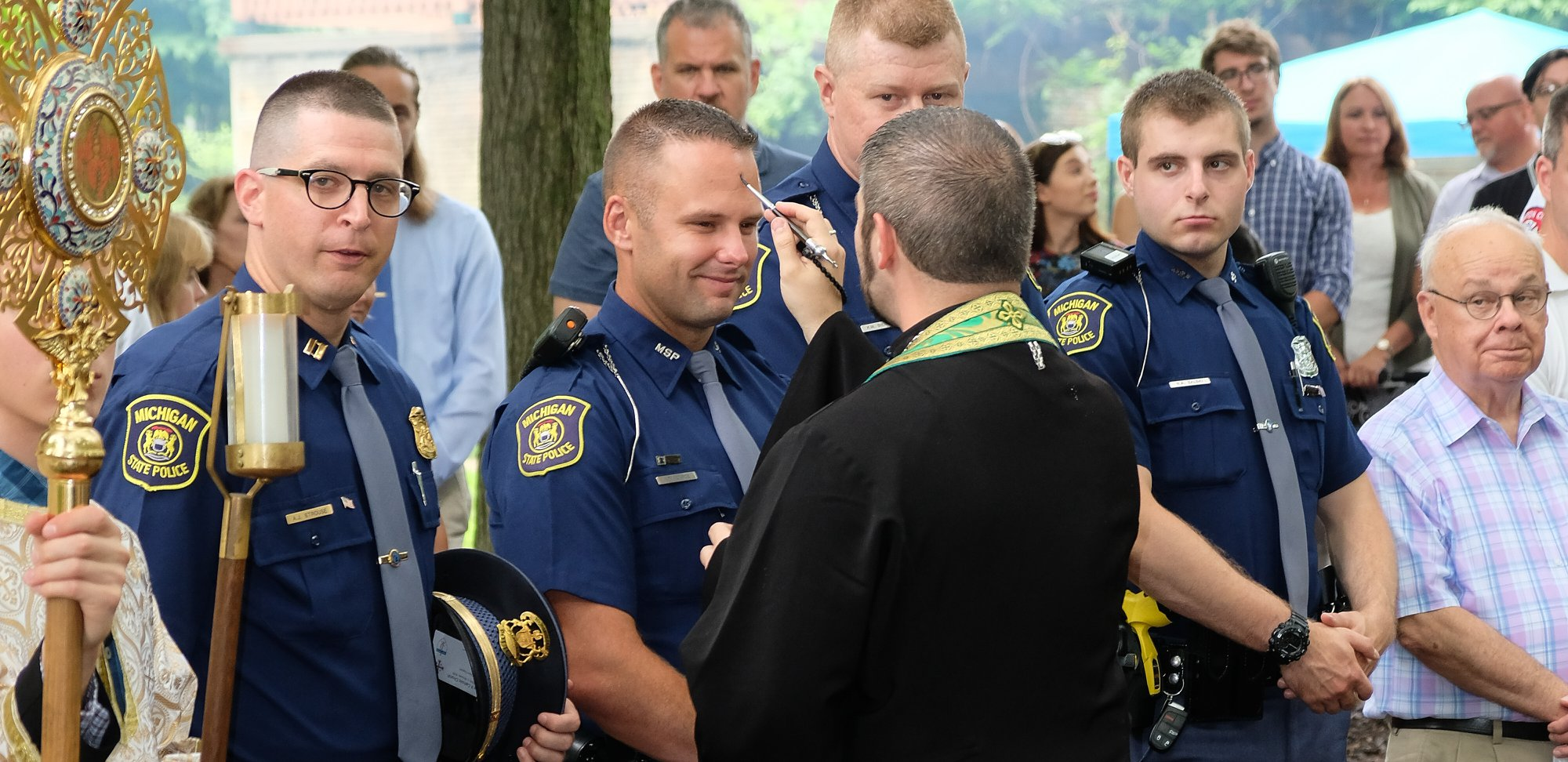 priest blessing short state trooper