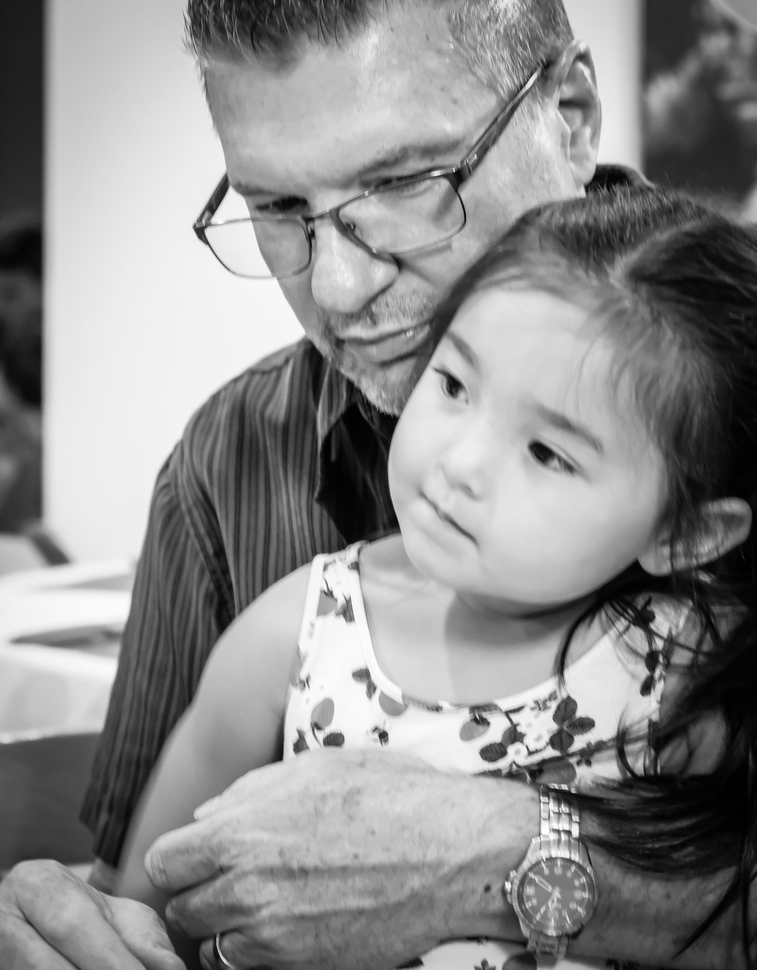 man holding grand-daughter black and white