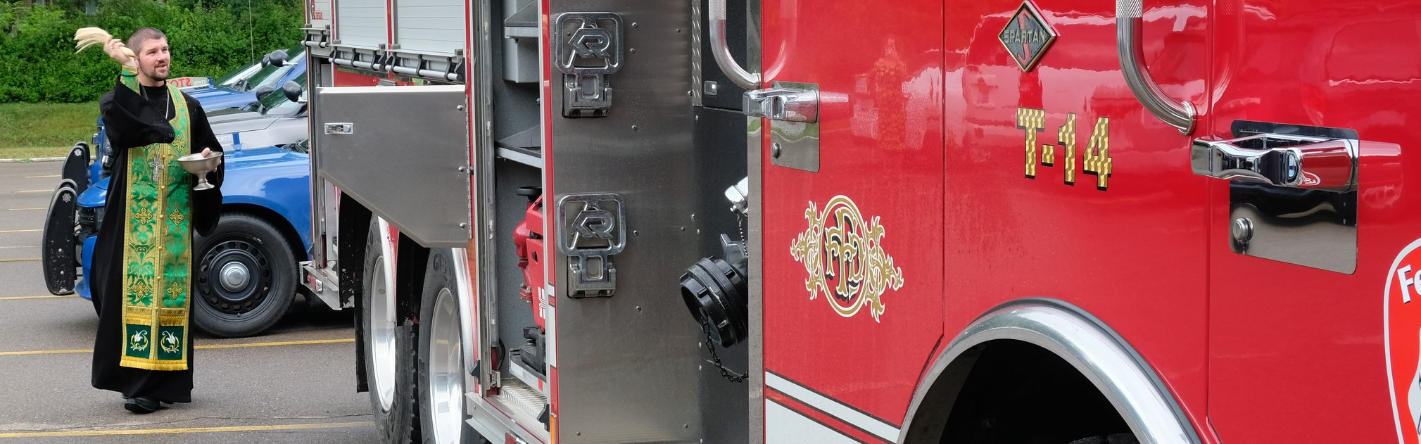 priest blessing fire truck panoramic