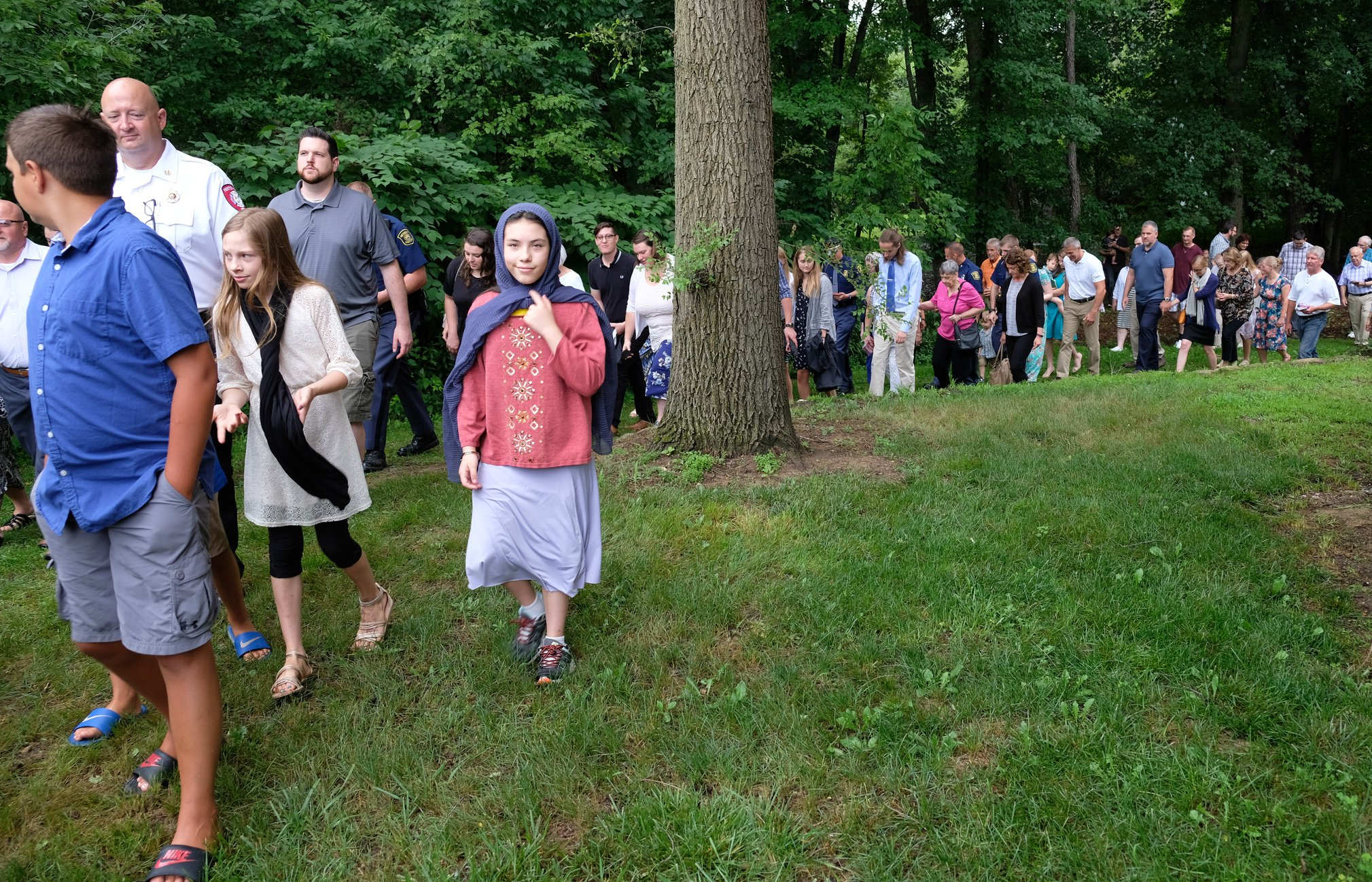 line of parishioners in outside procession