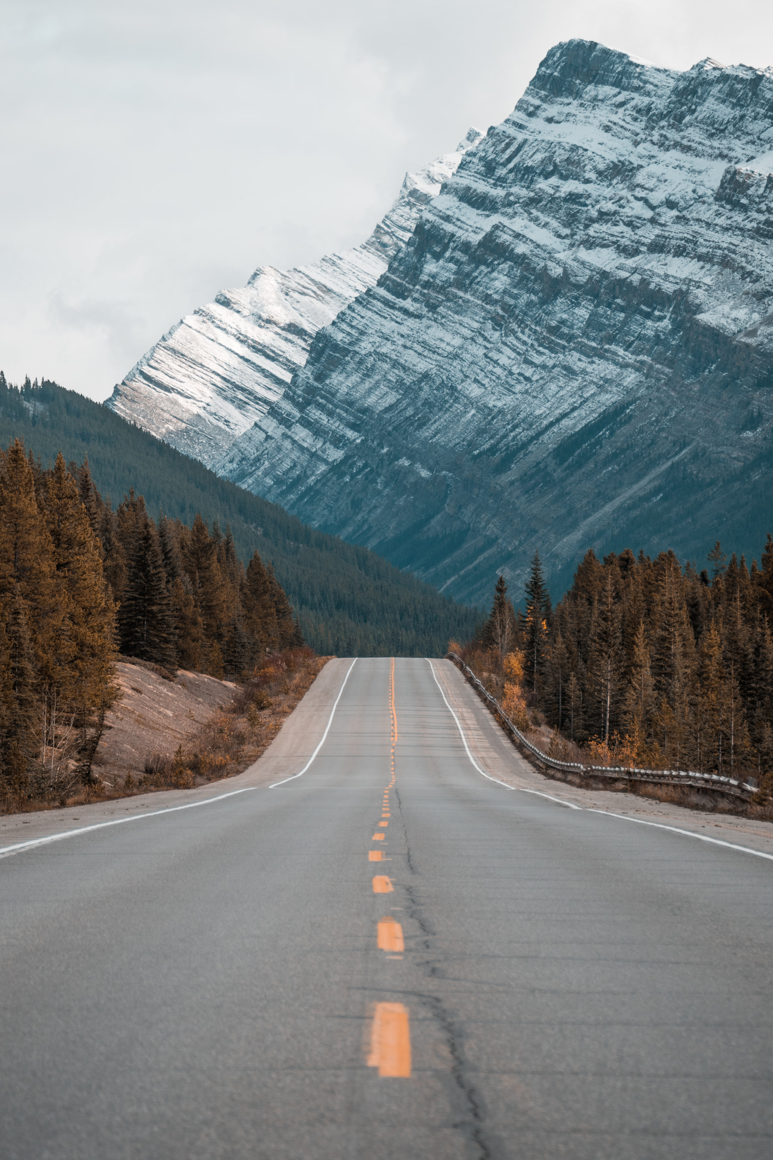 long straight road leading into the foot of a mountain