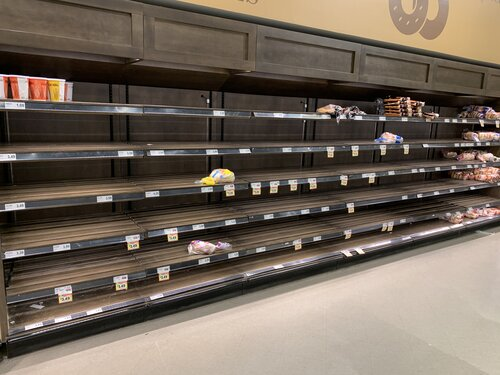 cleared and empty shelves at the supermarket
