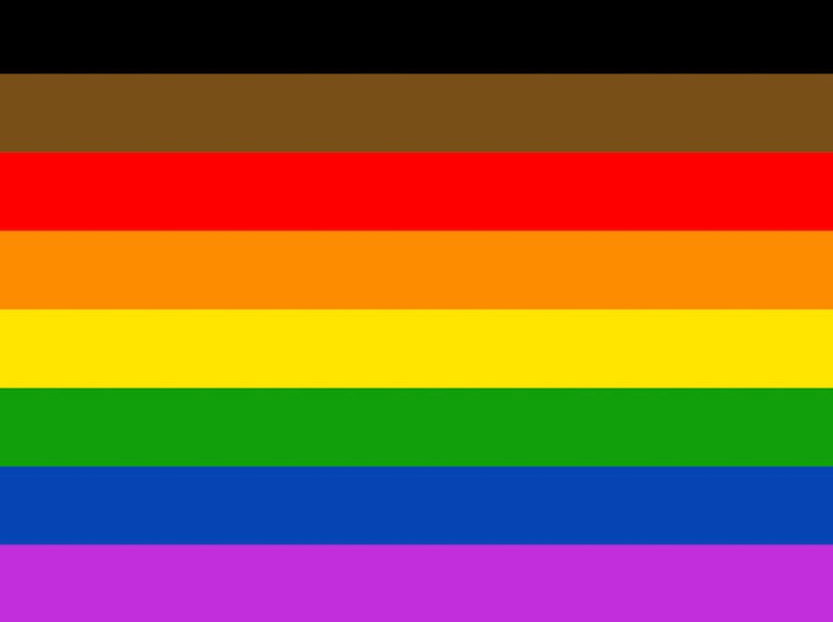 The original Rainbow Flag with last year's update by the city of Philadelphia, which added black and brown stripes to the top of the flag, to represent LGBT communites of colour.