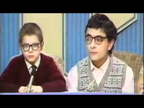 Rowan Atkinson and a little friend in the sketch:'Ask the family'.