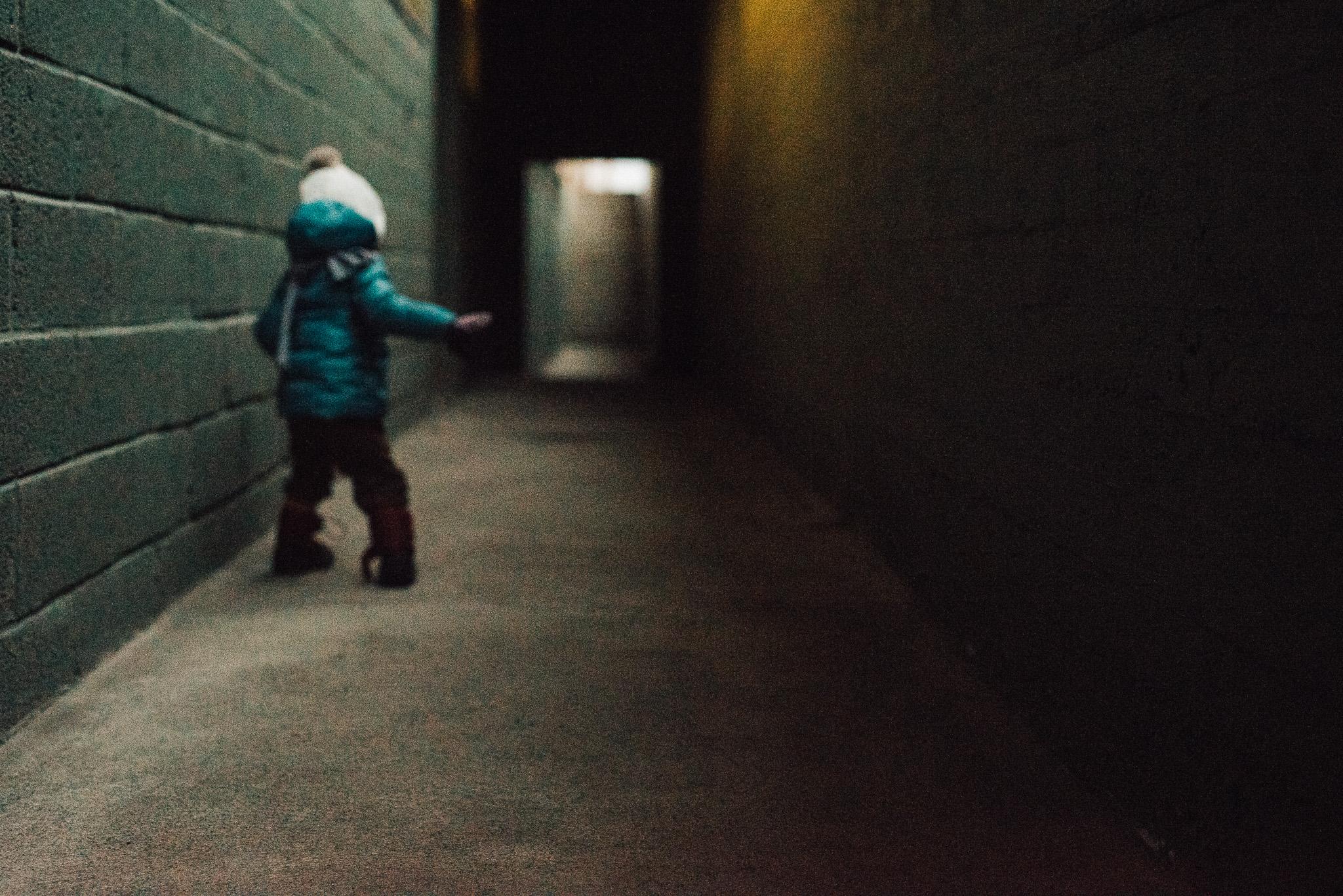 Child in corridor of basement apartments