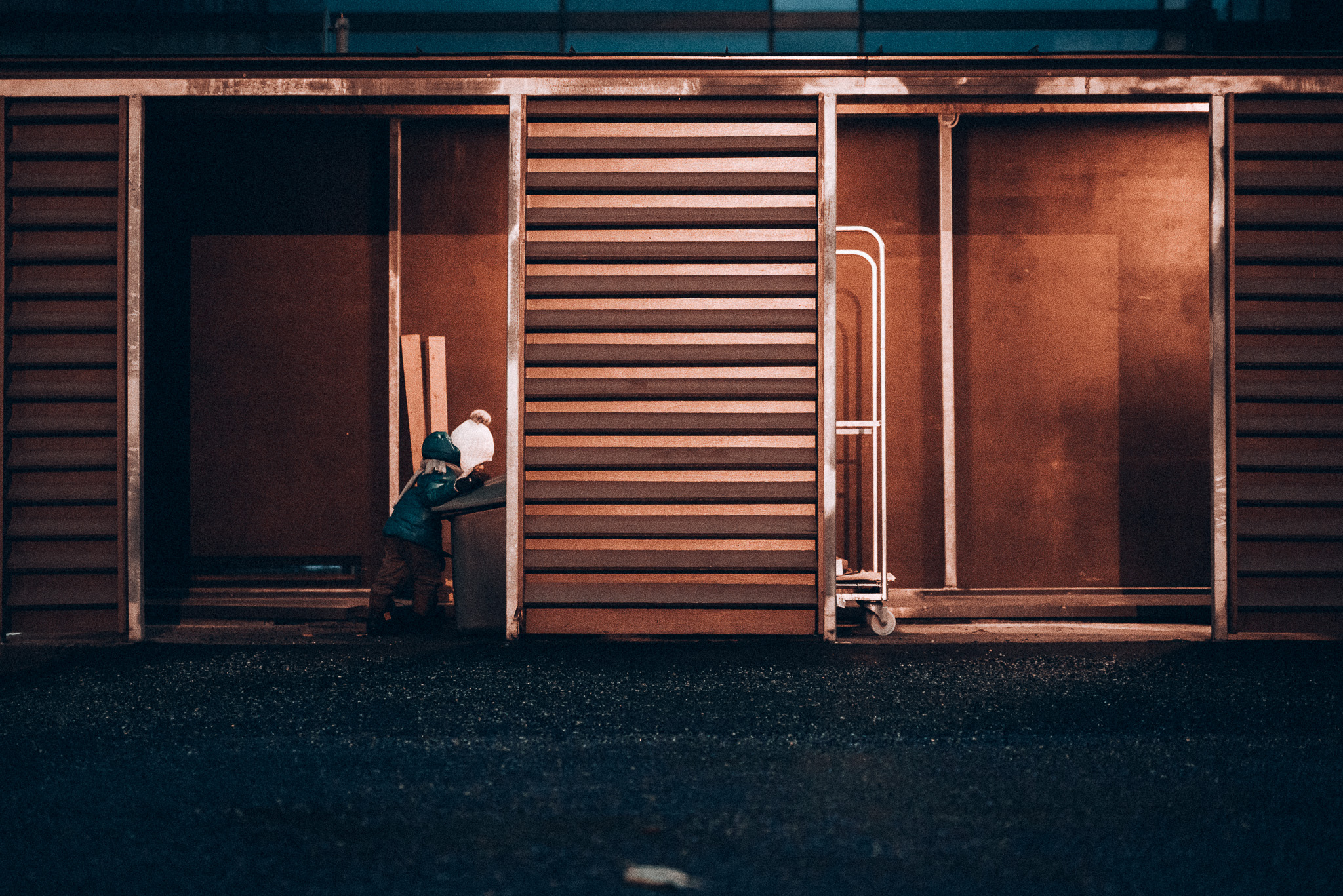 Child playing in garbage shack