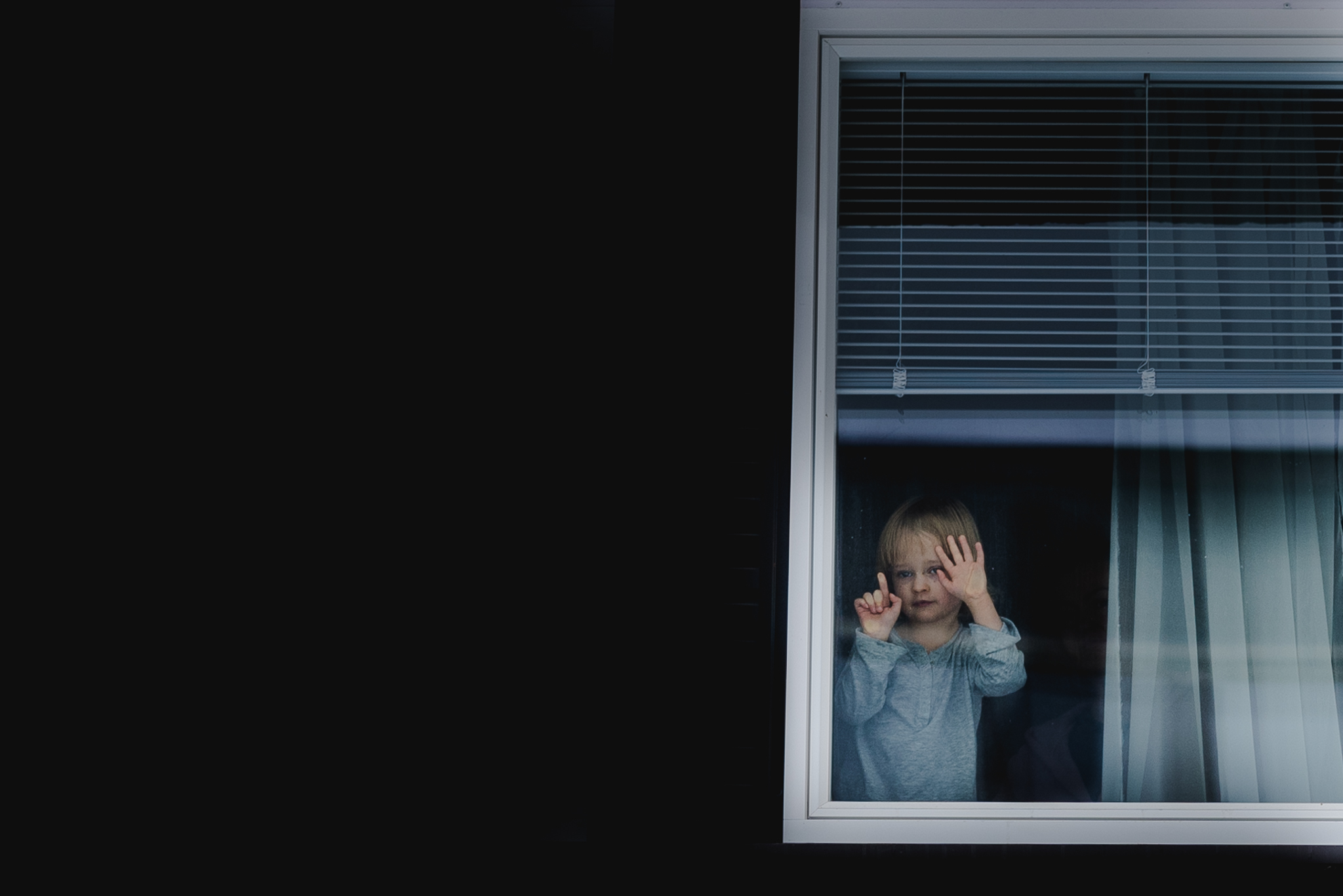 Little girl standing at the window