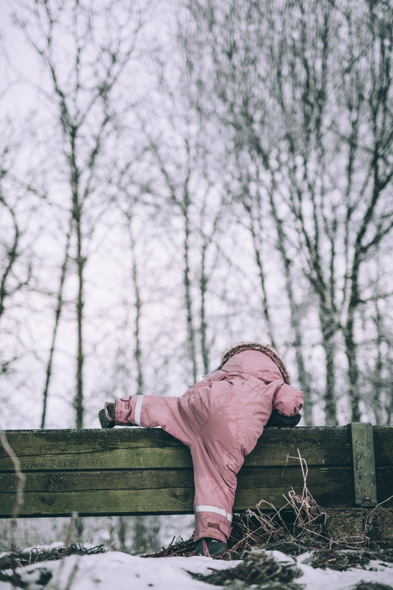 Child climbing a beam