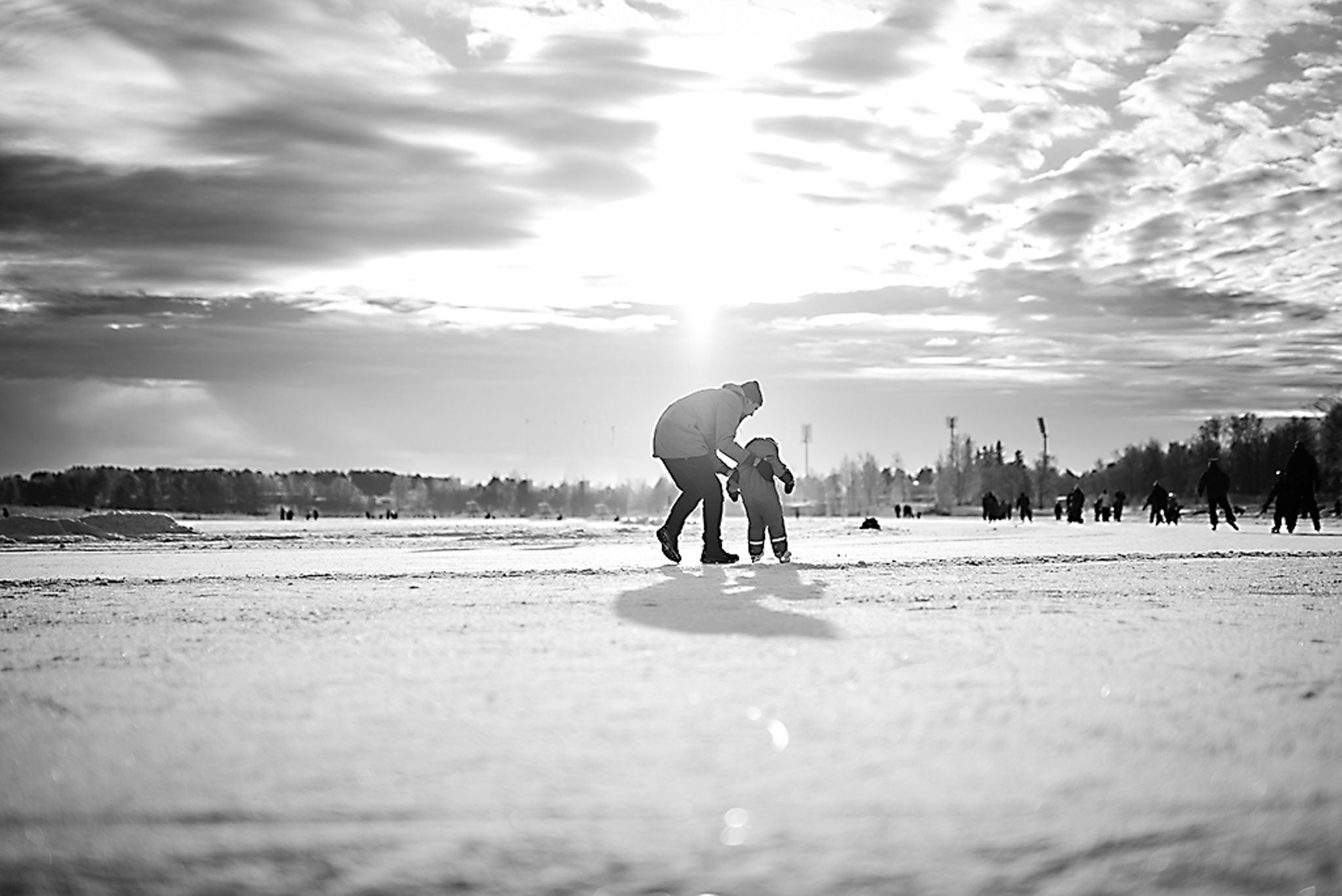 Man and child ice skating
