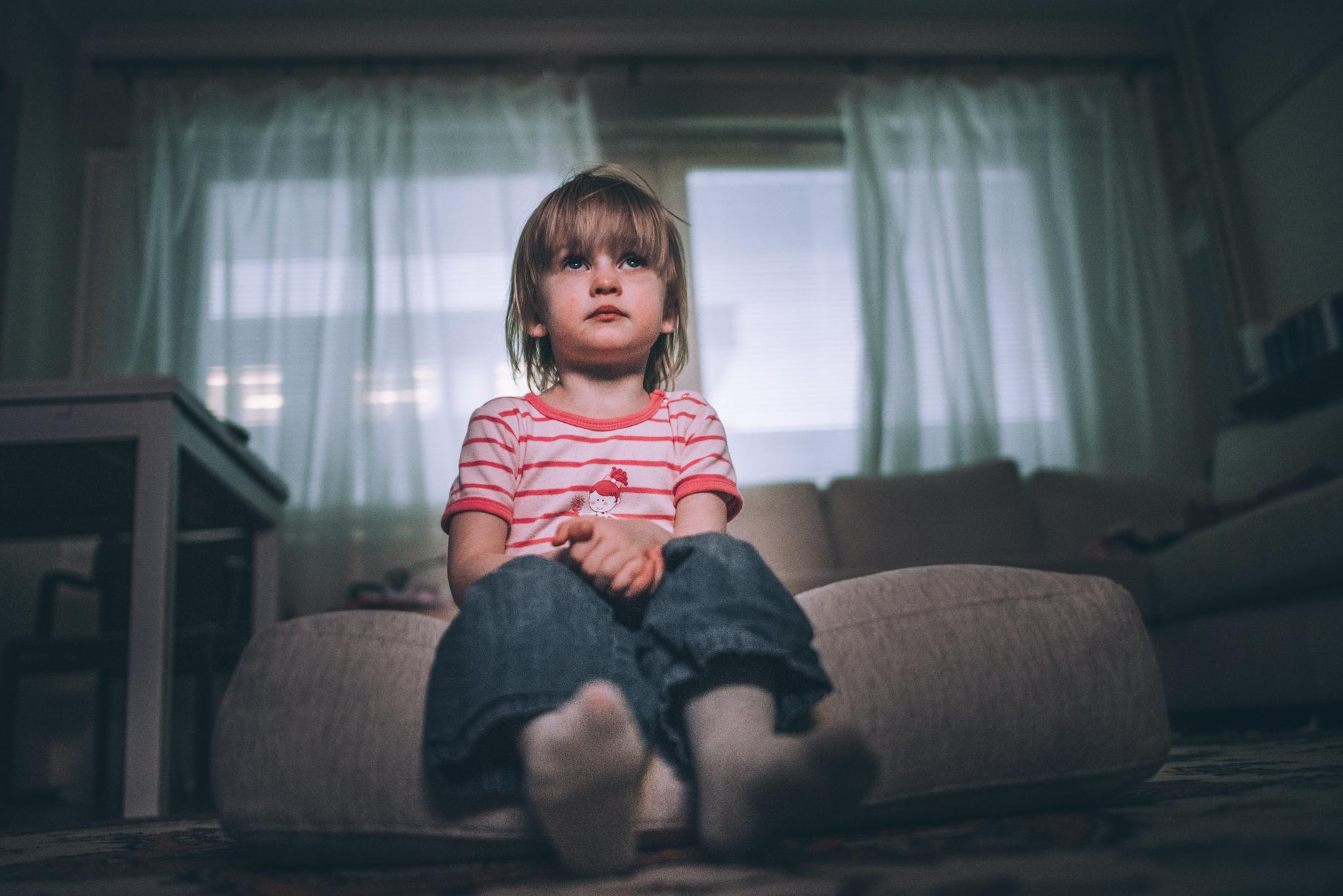 Child sitting and watching tv
