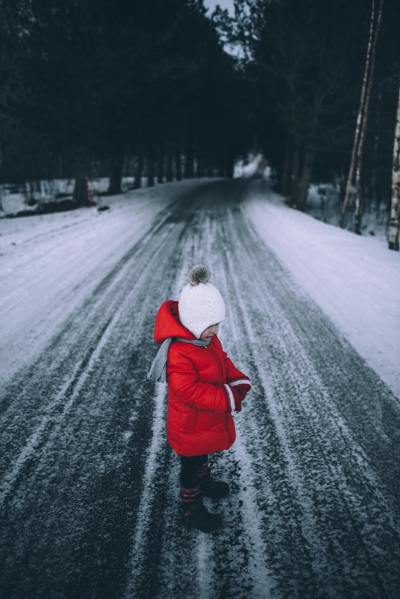 Girl in red anorak