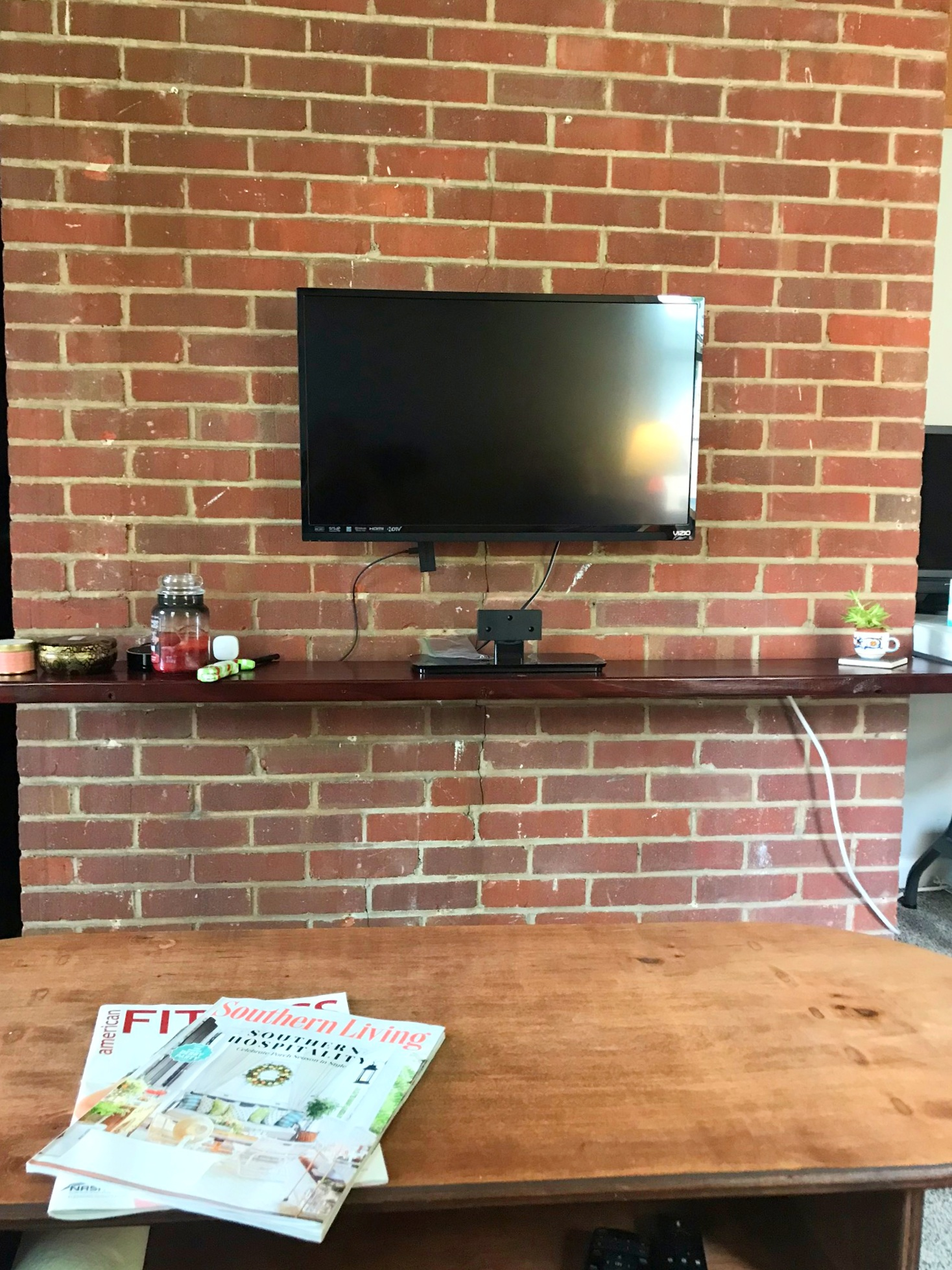 Room includes built in floating wood shelf and TV mount.  TV can be included as well along with other furniture by request.
