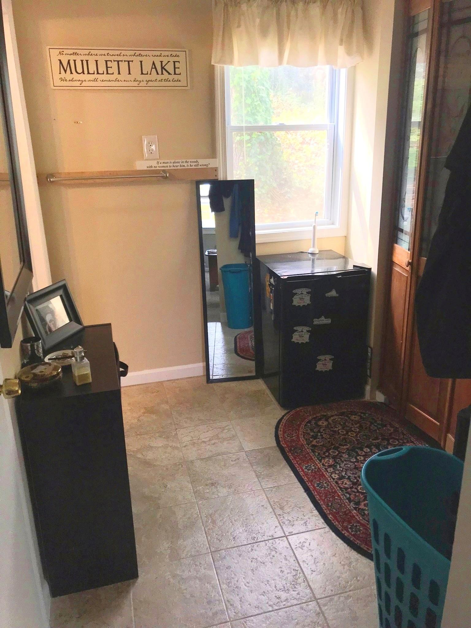Closet room - Bathroom left, full closet to the right.