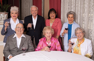 """The writer's mom, Babe Giese (sitting, in middle), enjoys a nightcap with friends (top row, from left) Blanche Abramson, Milton """"Mitty"""" Tartakov, Elma Colindres, Flo Selber, (front, from left) Hymie Abramson and Geneva Carter."""