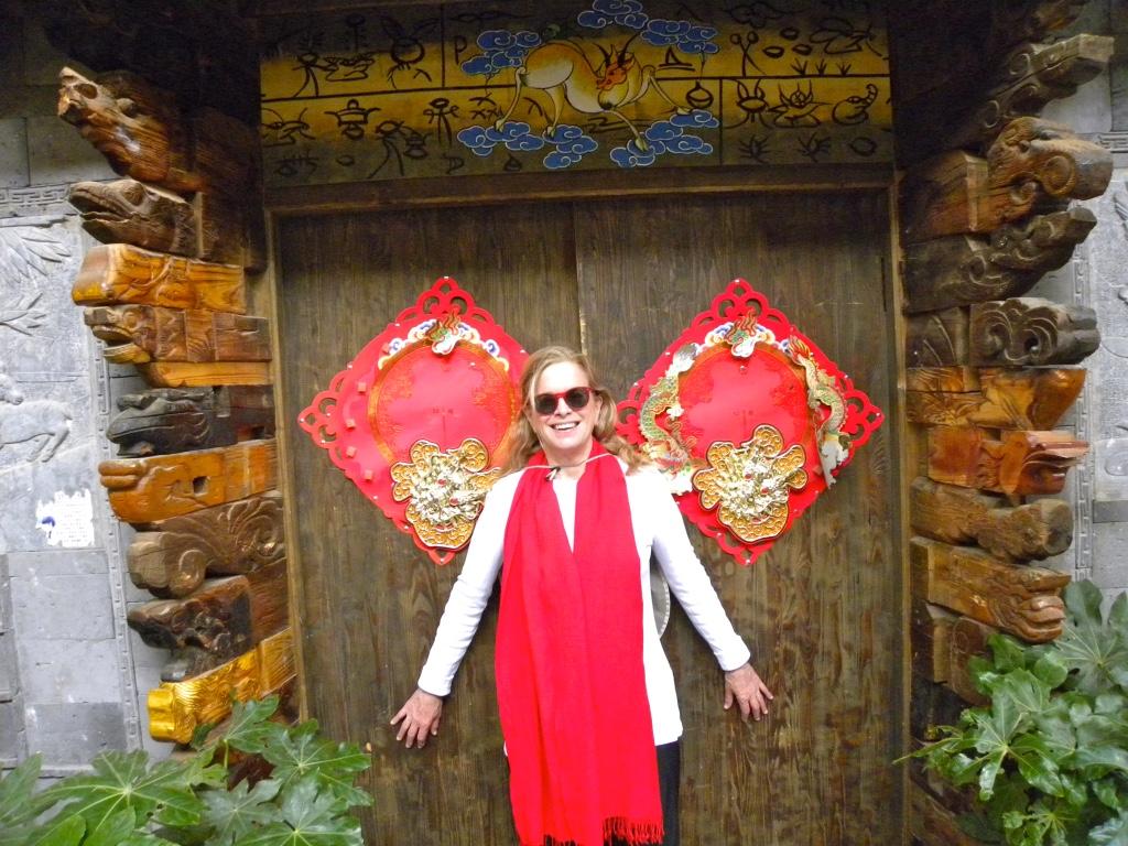 Author in doorway Lijiang Old Town, China