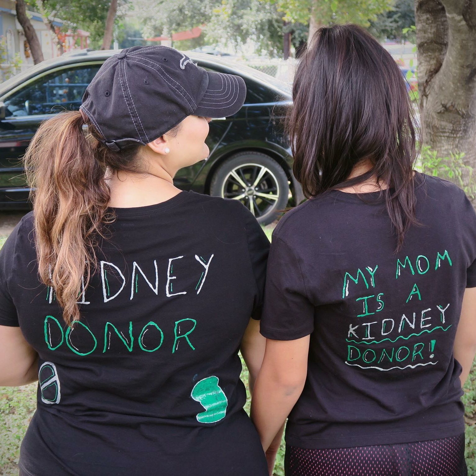 Me and one of my teenagers sporting the t-shirts we made for the Kidney Walk. 4 months post surgery.