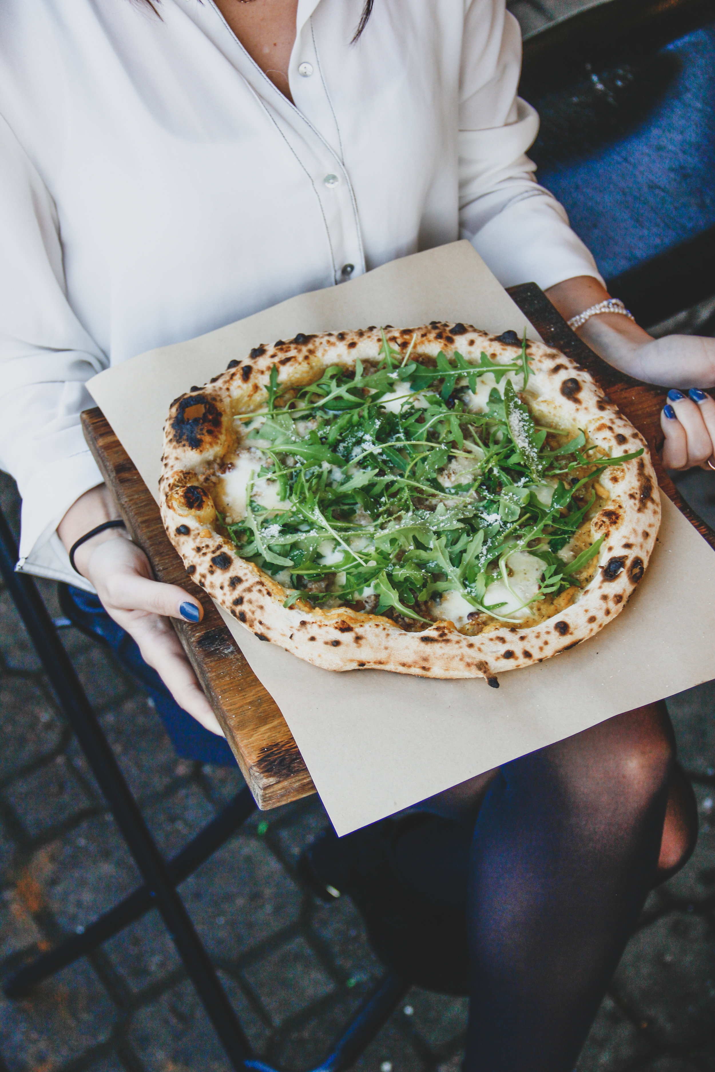 Pizza Aurora 10€    Pumpkin cream, fior di latte cheese, Gorgonzola cheese, pork, walnuts, rucola, Parma cheese, olive oil, lemon zest   You only need to read the list of the pizza's components to understand that this is not a basic pizza. A large portion of rucola made this pizza extremely fresh!