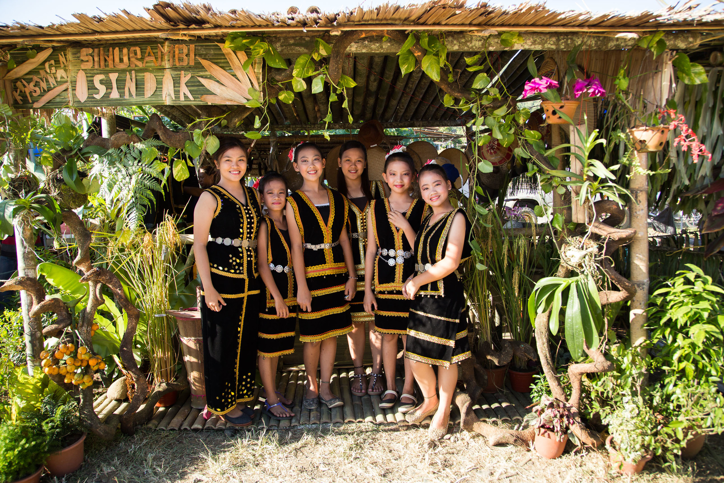 Young women posing at a hut. Credit: Jeremiah Sebastian Photography