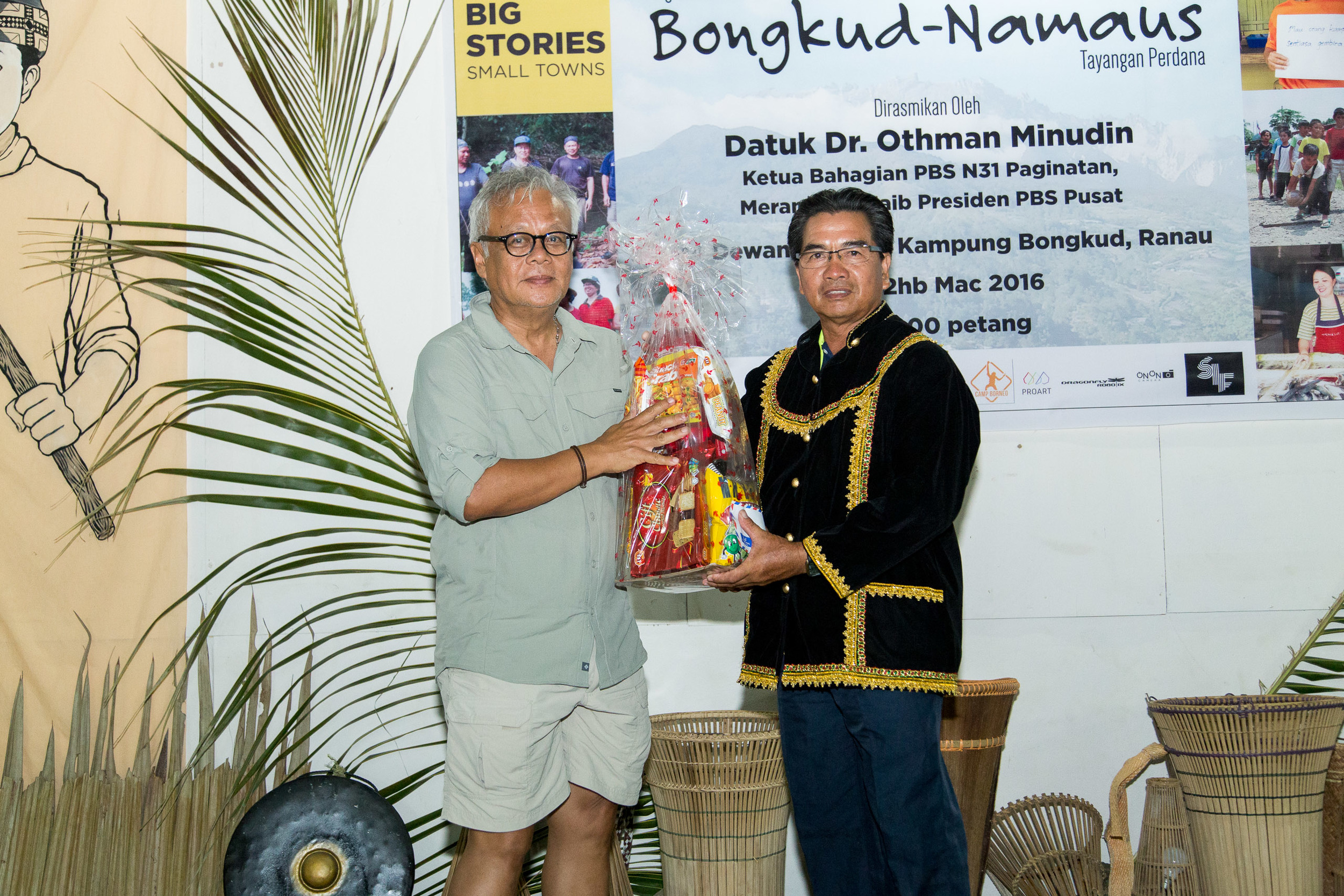 Kampung Bongkud Village Chief and community filmmaker receiving an award from Datuk Dr. Johan Arriffin Samad. Picture by Jeremiah Sebastian