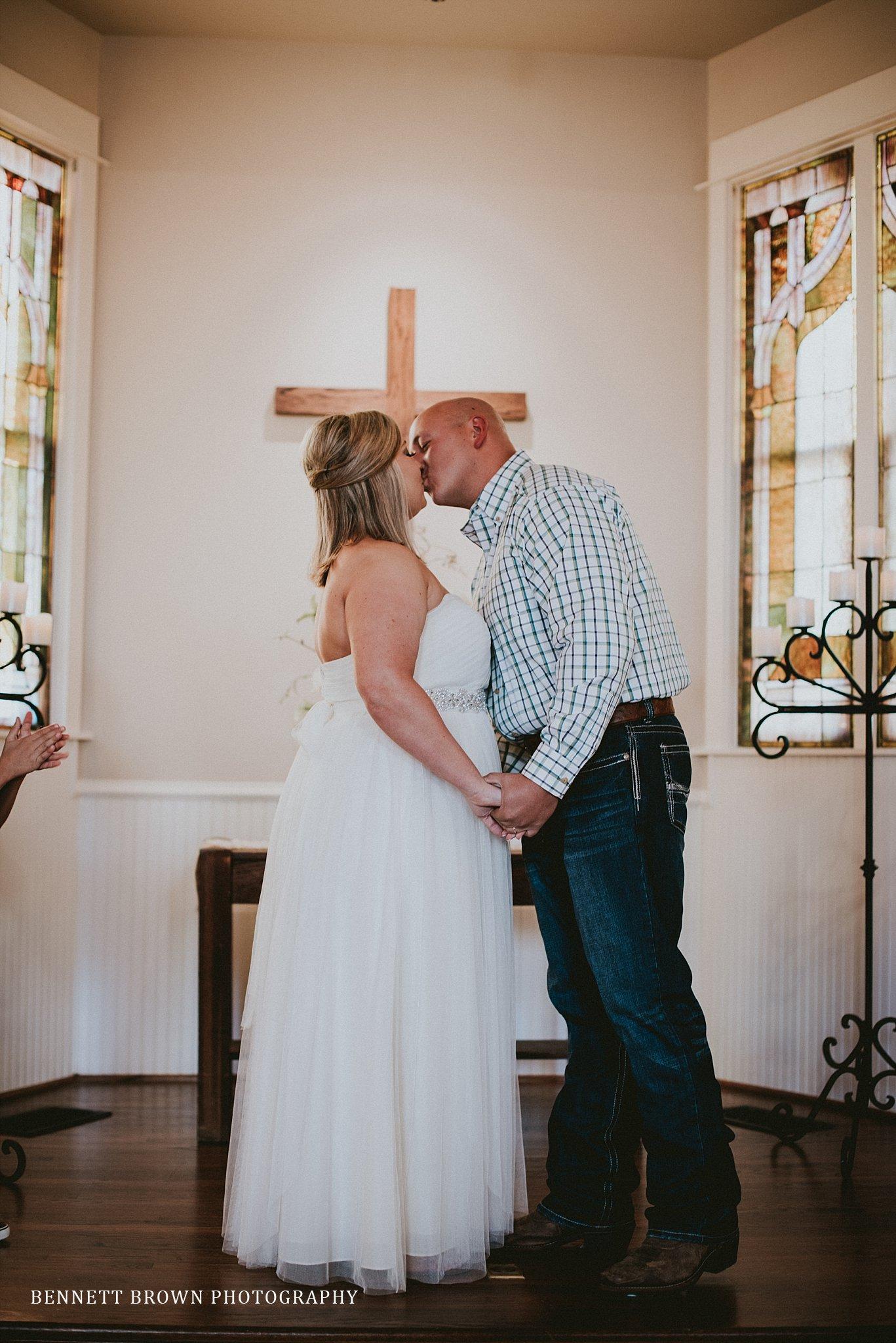 Bennett Brown Photography Chapel Church alter bride groom kiss