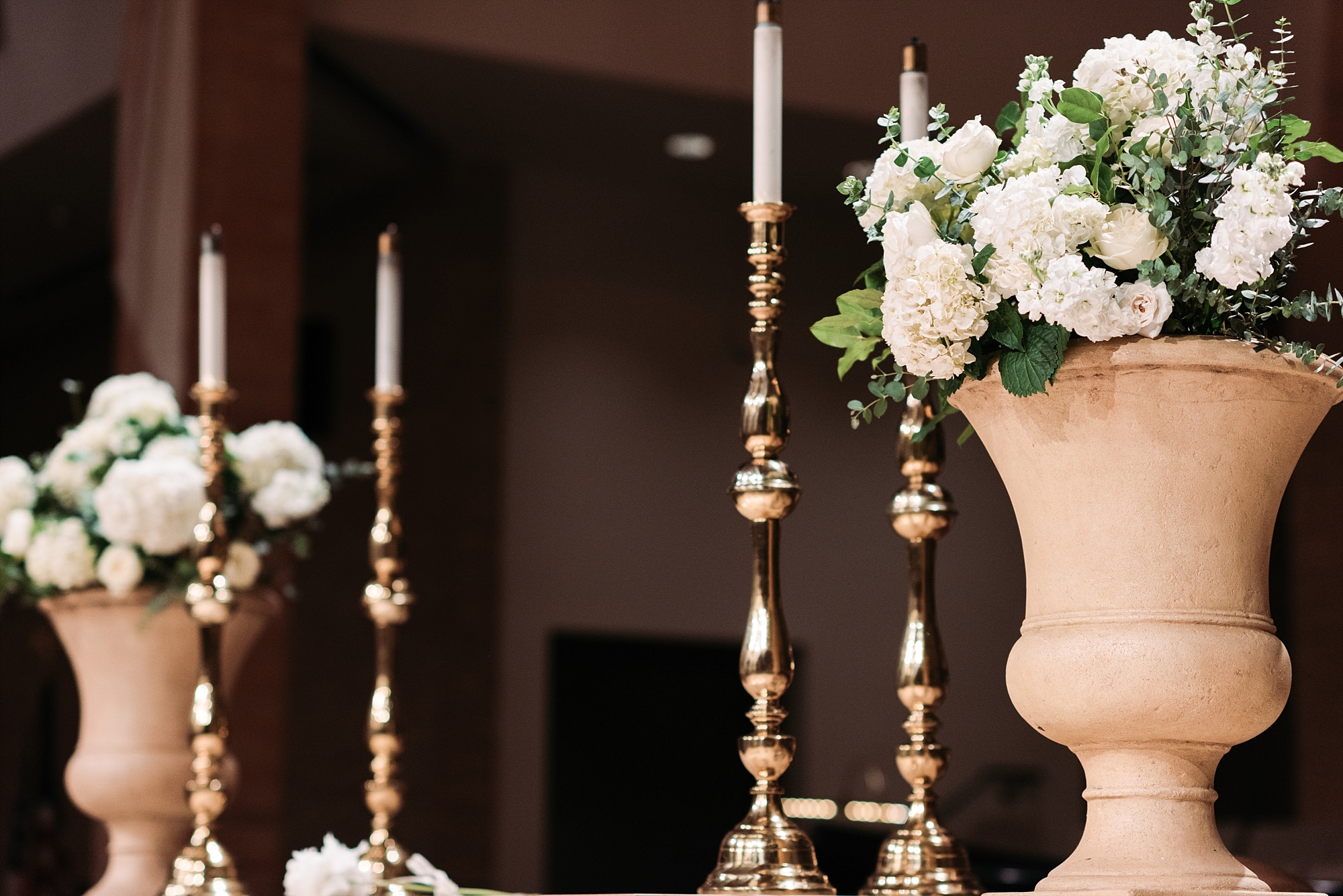 Wedding details photography hydrangeas candle sticks chapel