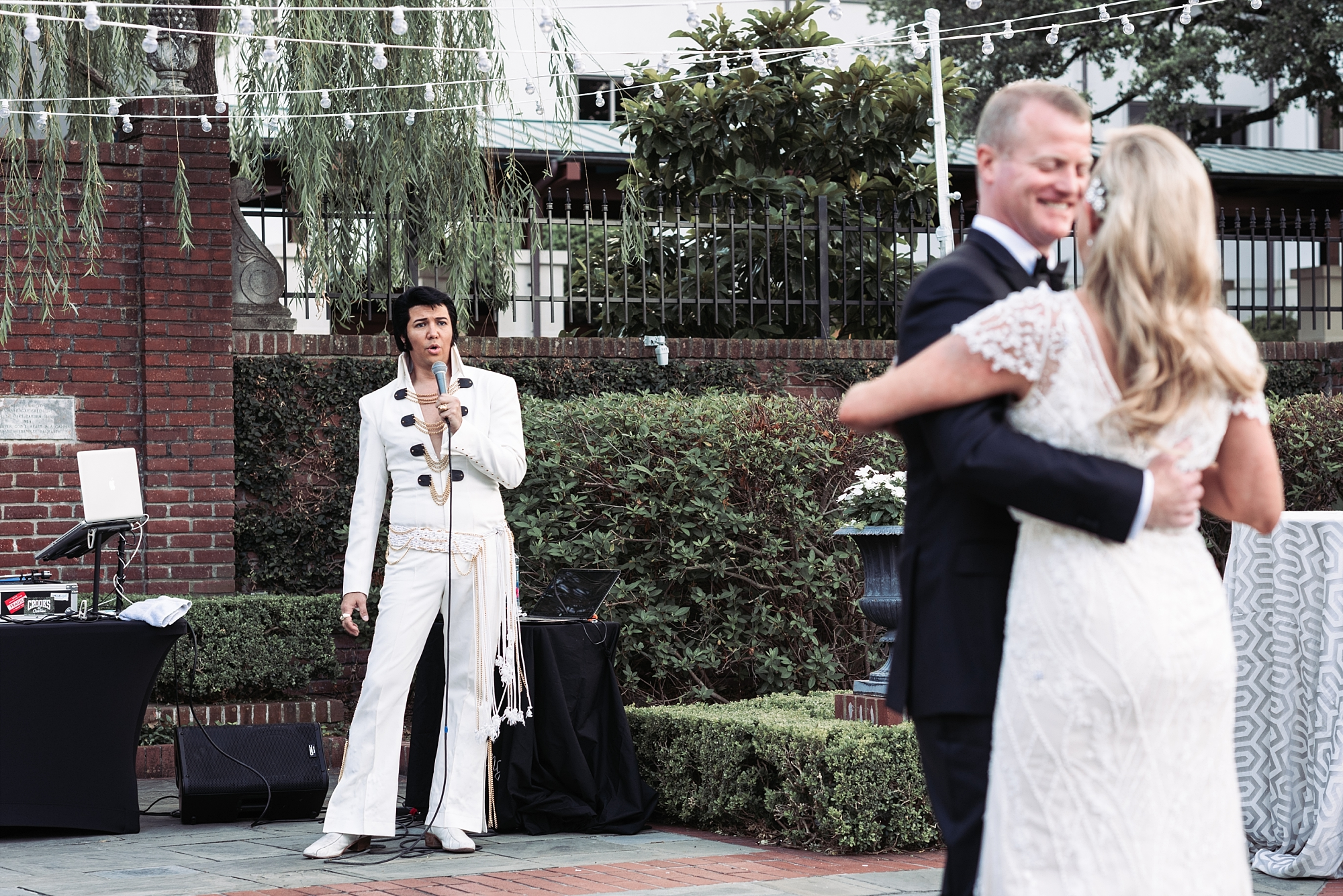 Elvis impersonator Wedding reception dance bride groom wedding portrait photography