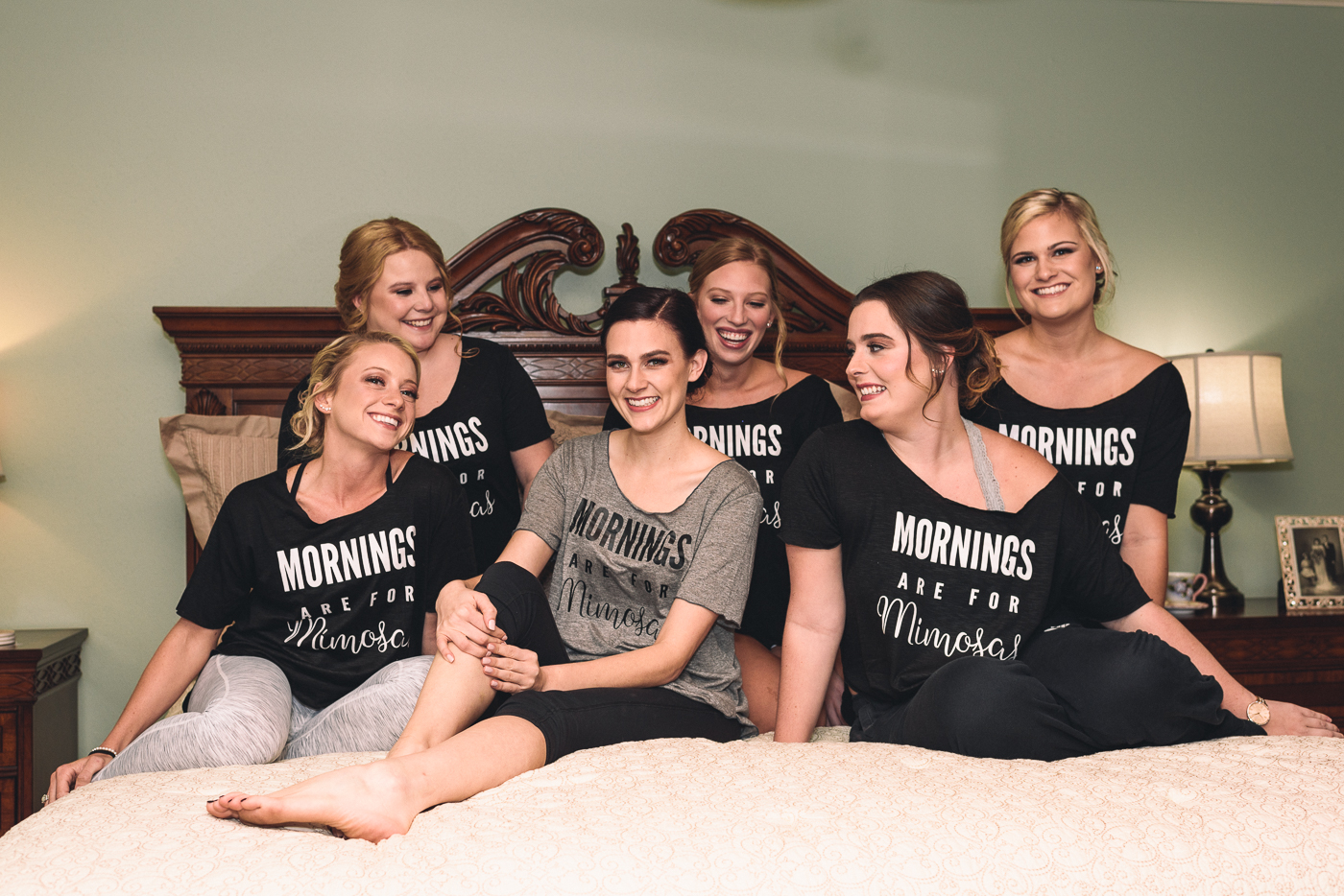 bride and bridesmaids getting ready mornings are for mimosas maid of honor