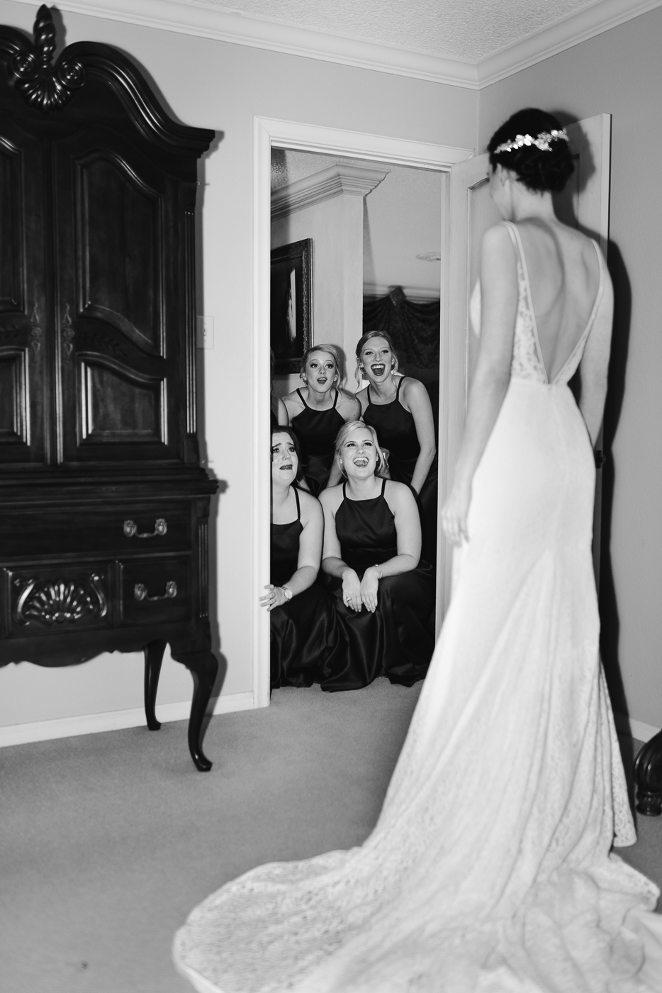 black and white first look bridesmaids happy friends open back wedding gown