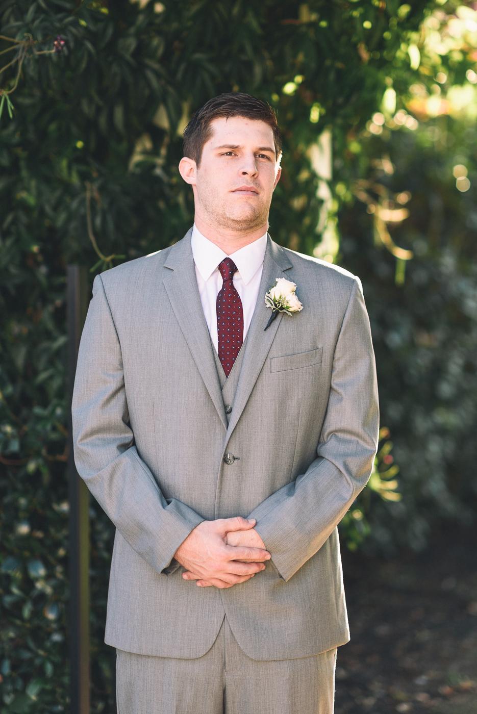dapper groom grey suit portrait boutonniere