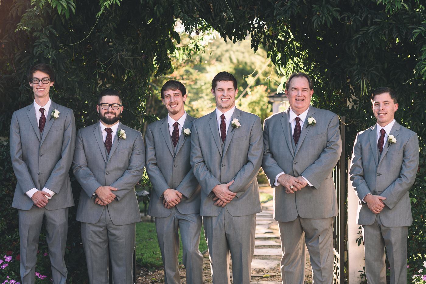 Groomsmen portraits father and son boutonniere grey suit maroon tie