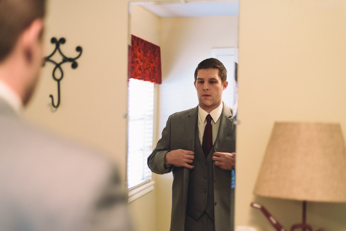 groom dressing getting ready suit and tie mirror