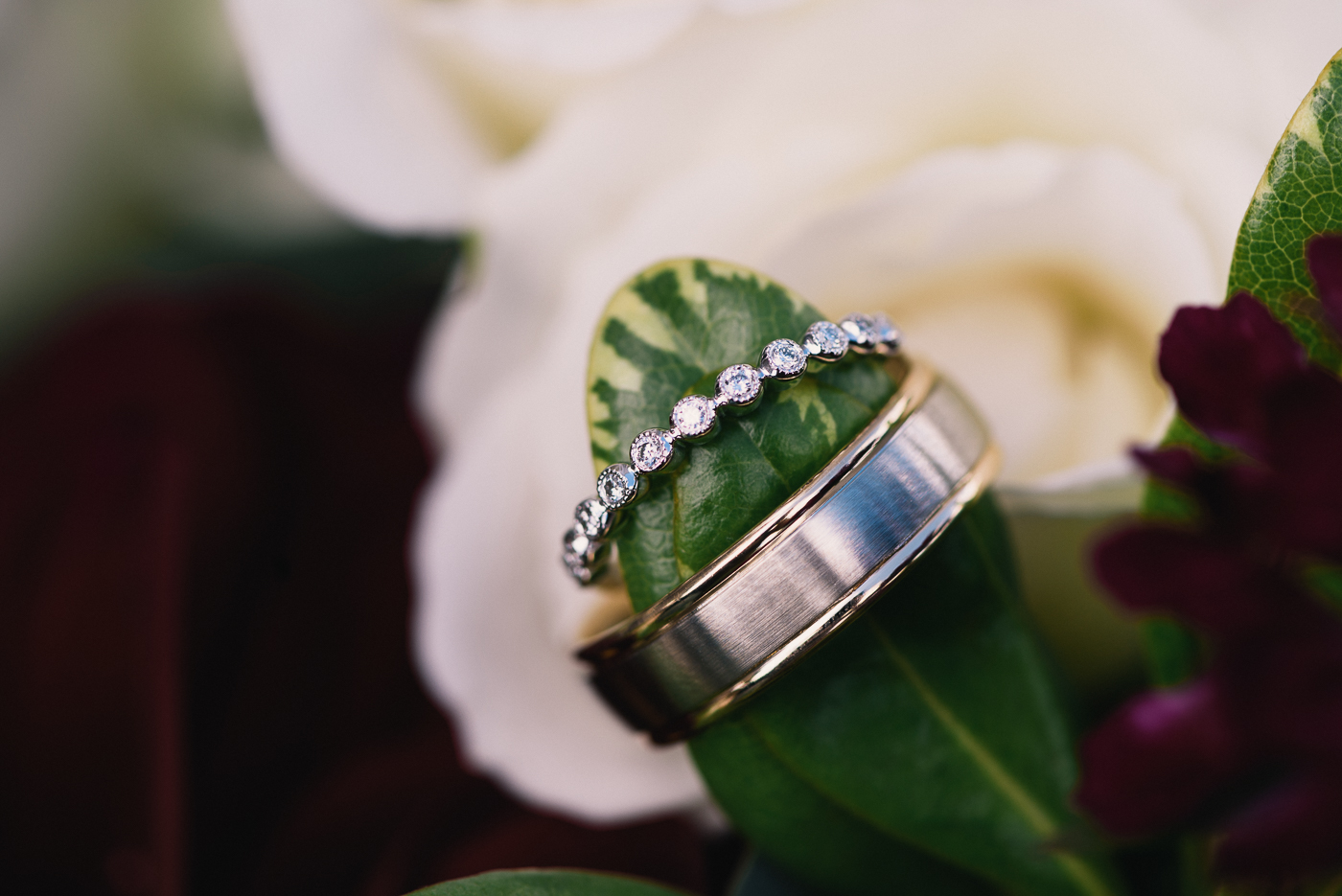 His and Hers wedding rings wedding bands diamonds flowers bouquet