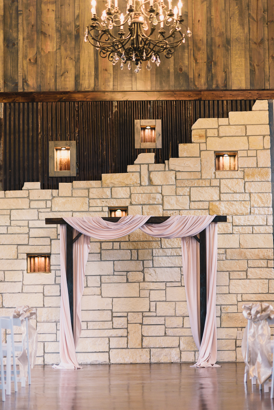 Pink wedding arch limestone wall rustic sheet metal shiplap wood pannel