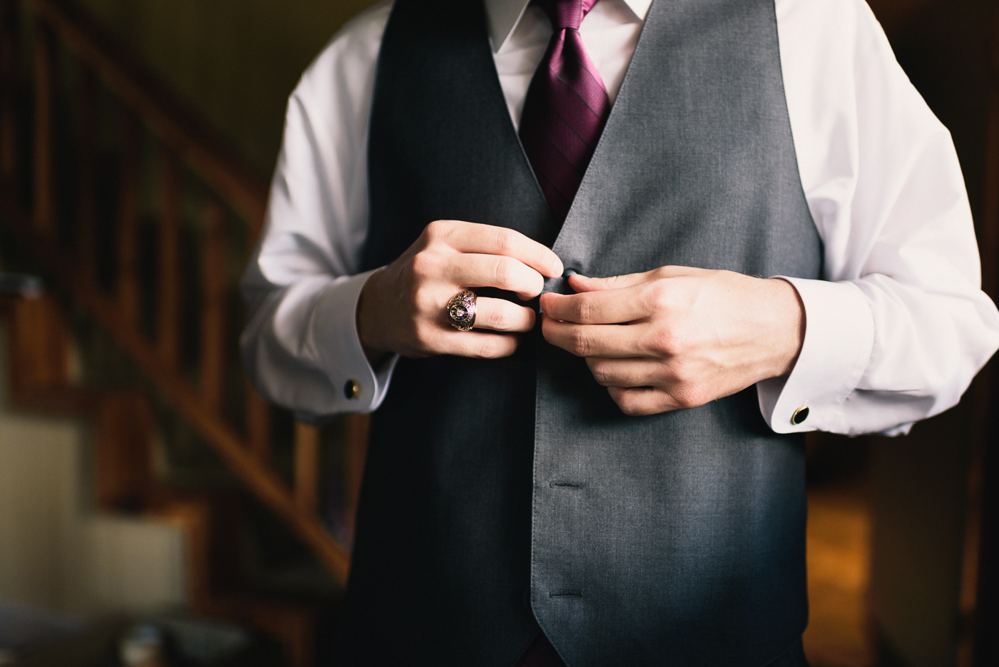 Getting ready shot groom vest maroon tie Texas A&M Ring Aggie Ring Fightin' Texas Aggies