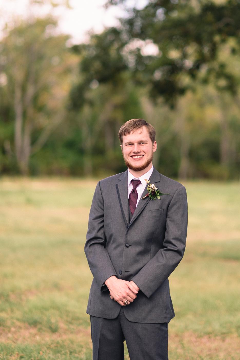 Groom Portrait Maroon tie Texas A&M Ring Texas Aggie Ring Boutonniere beard