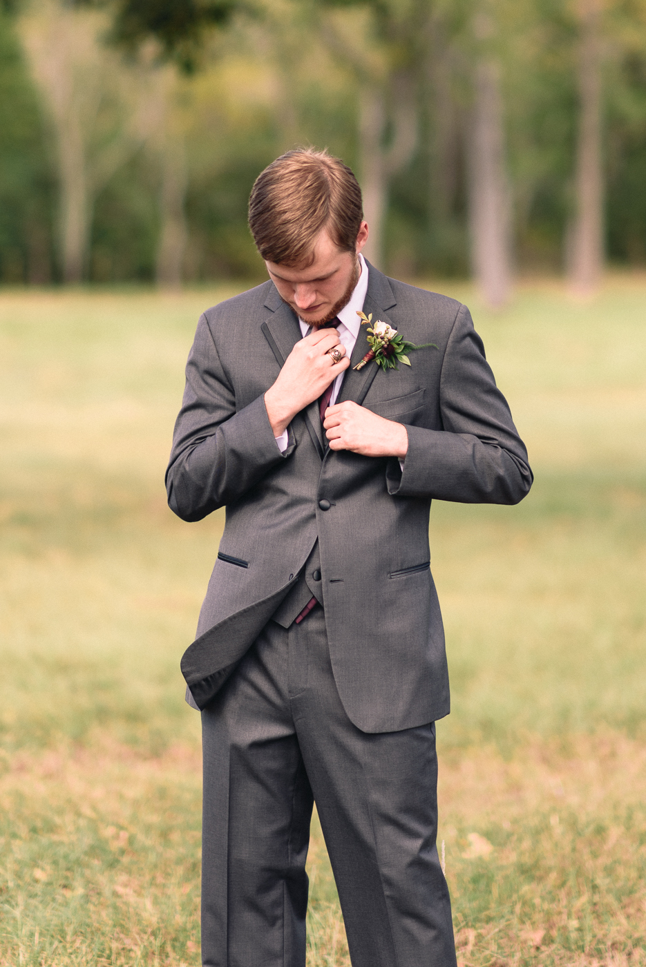 Groom Portrait Maroon tie Texas A&M Ring Texas Aggie Ring Boutonniere wing movement beard